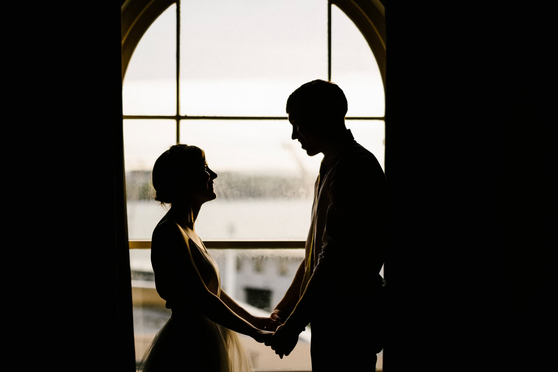 bride and groom by the window port rush town hall wedding photography northern ireland