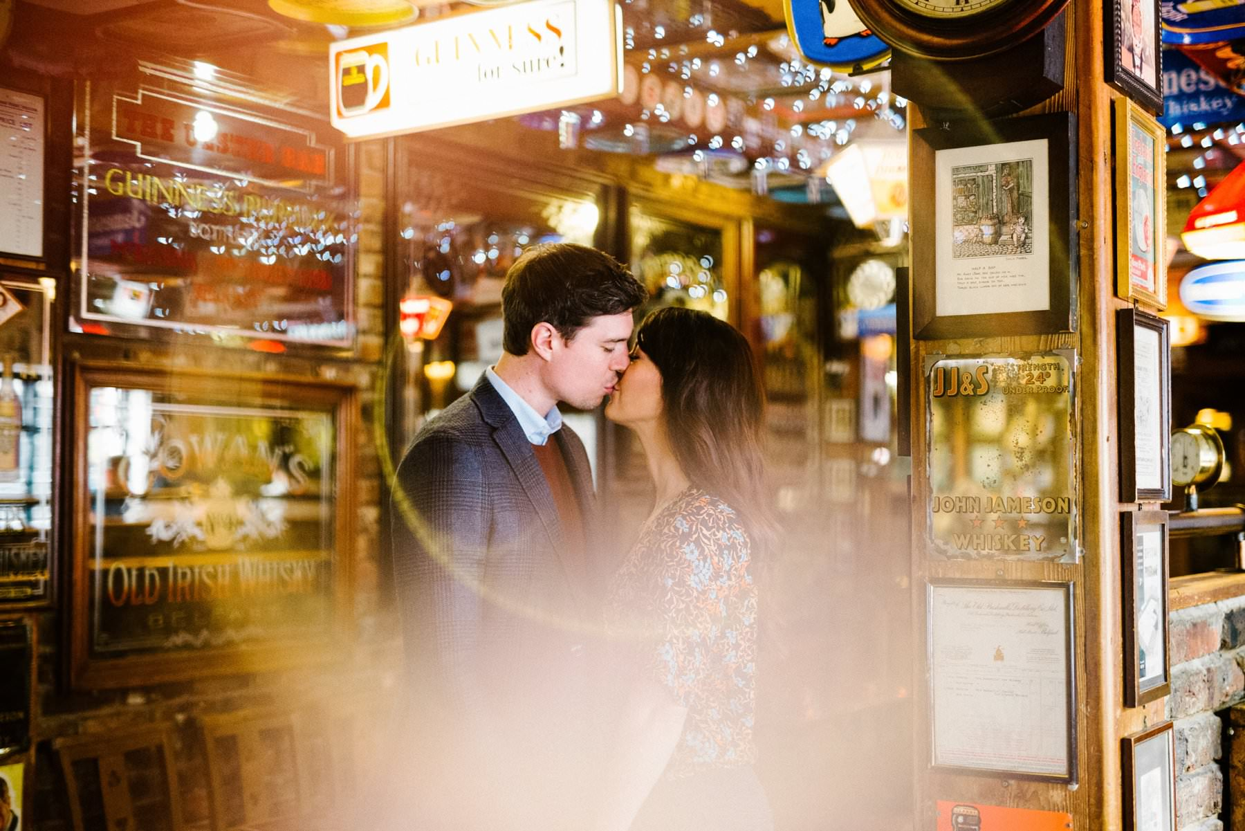 engagement photoshoot using the ring of fire inside pub in belfast northern ireland