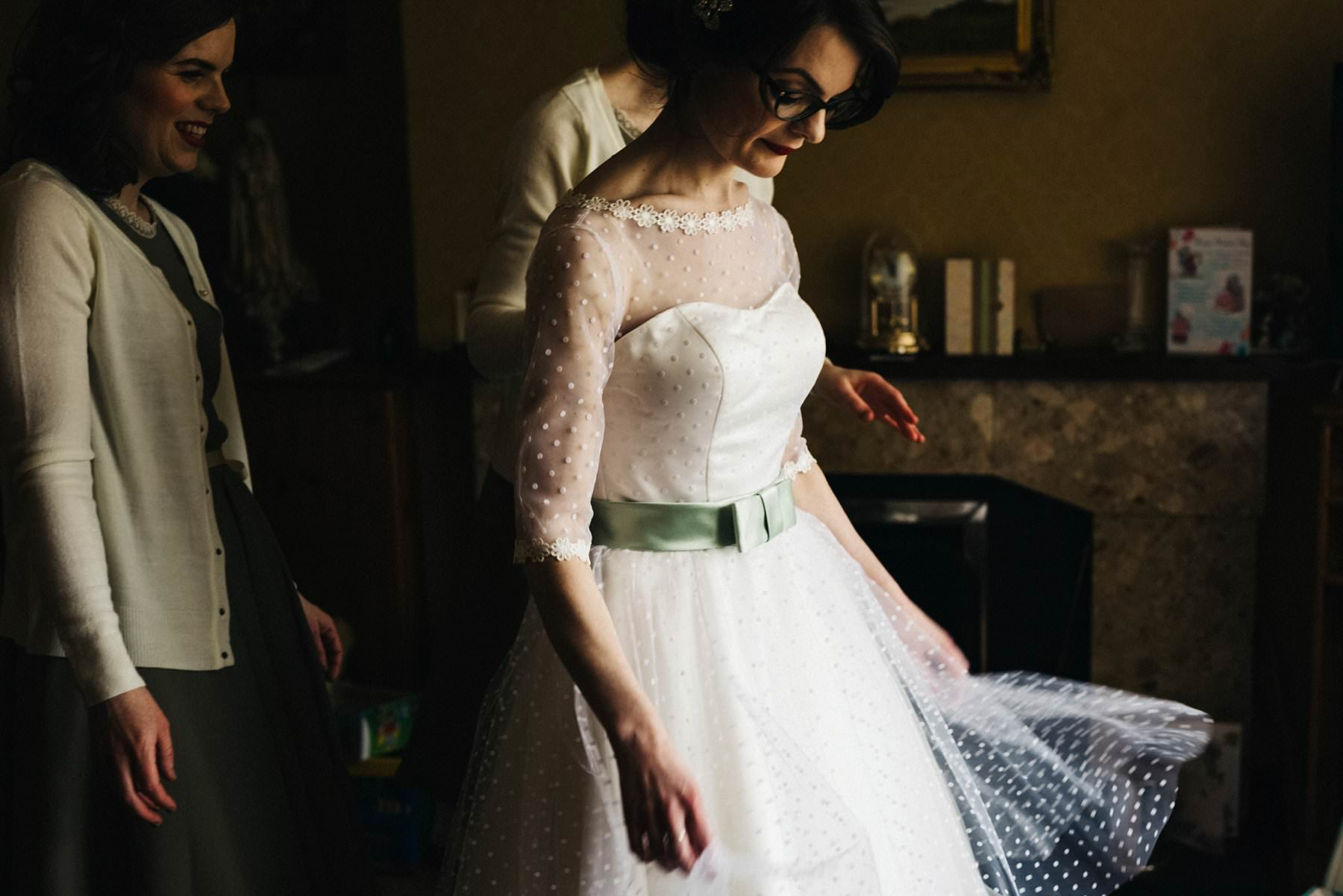 bride getting into wedding dress wedding photography northern ireland