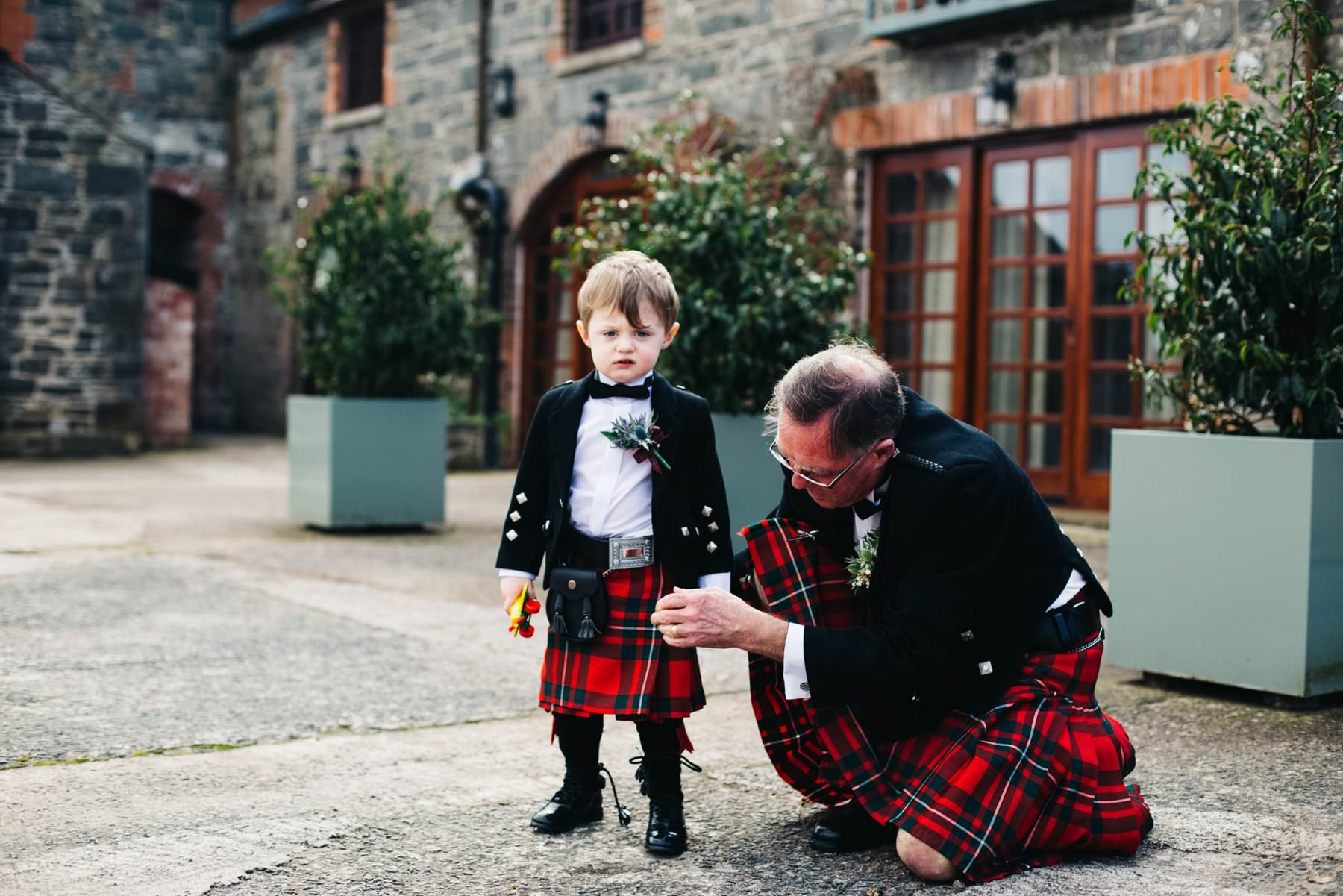little page boy in kilt at wedding photography larch field estate northern ireland