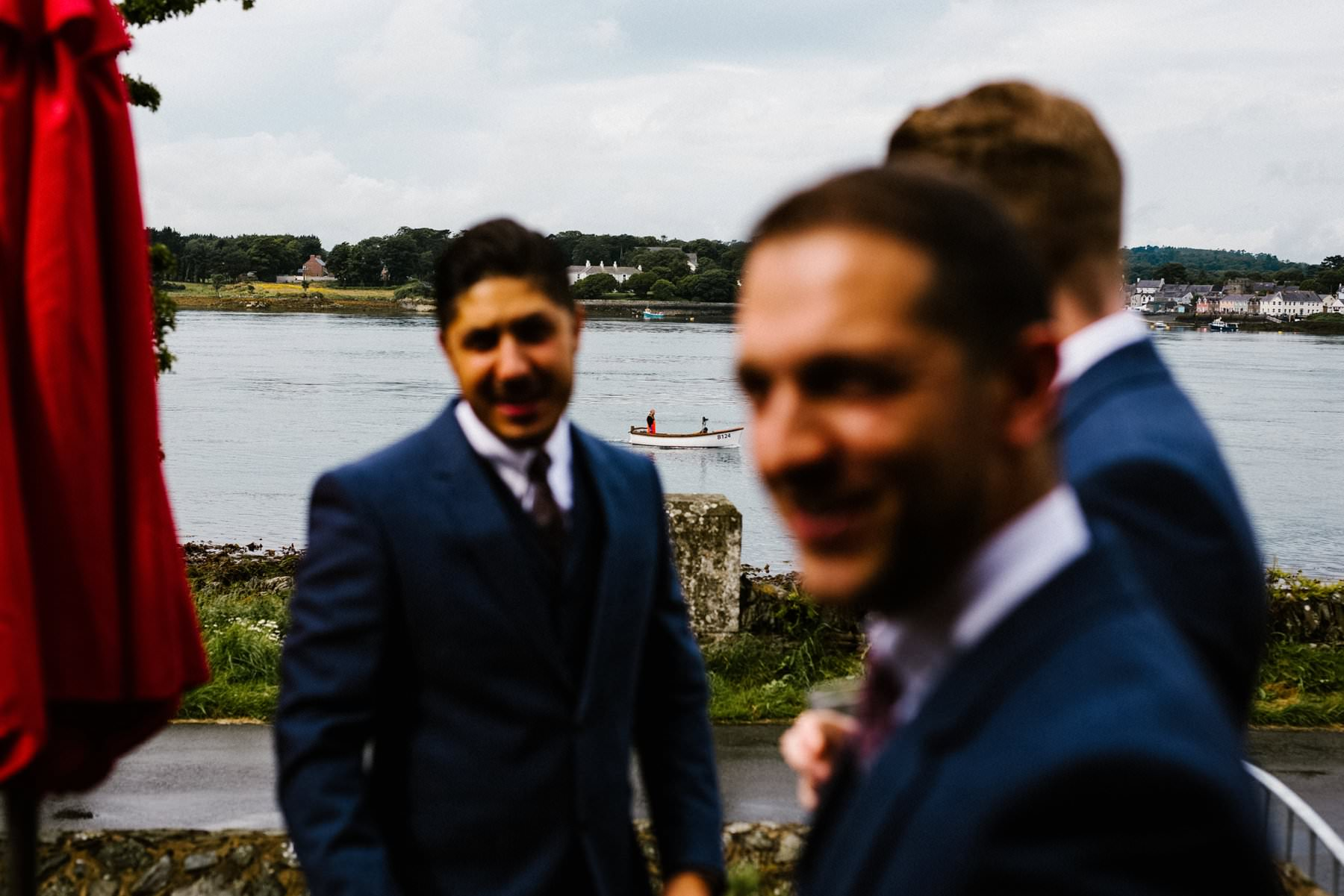 boat sails by groom on wedding day, wedding photographer northern ireland