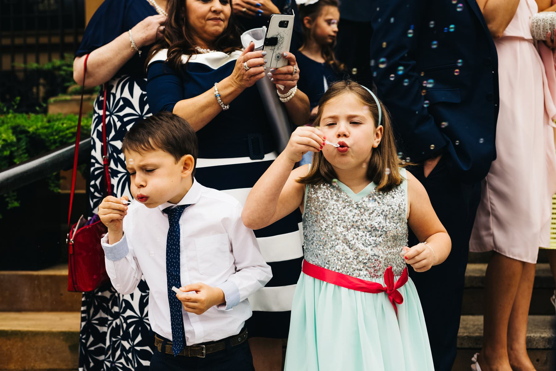 kids blowing bubbles at belfast wedding photographer