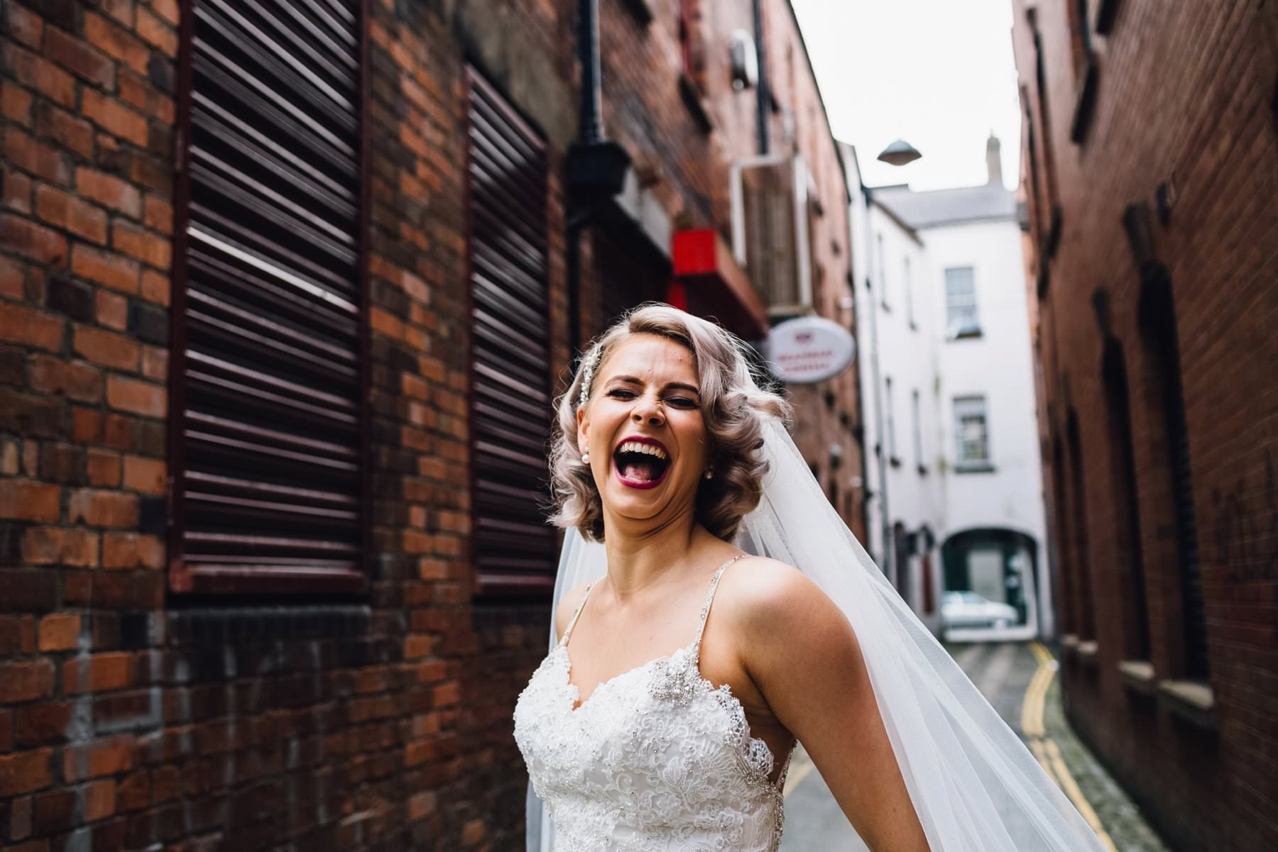 portrait of laughing bride wedding photography belfast northern ireland