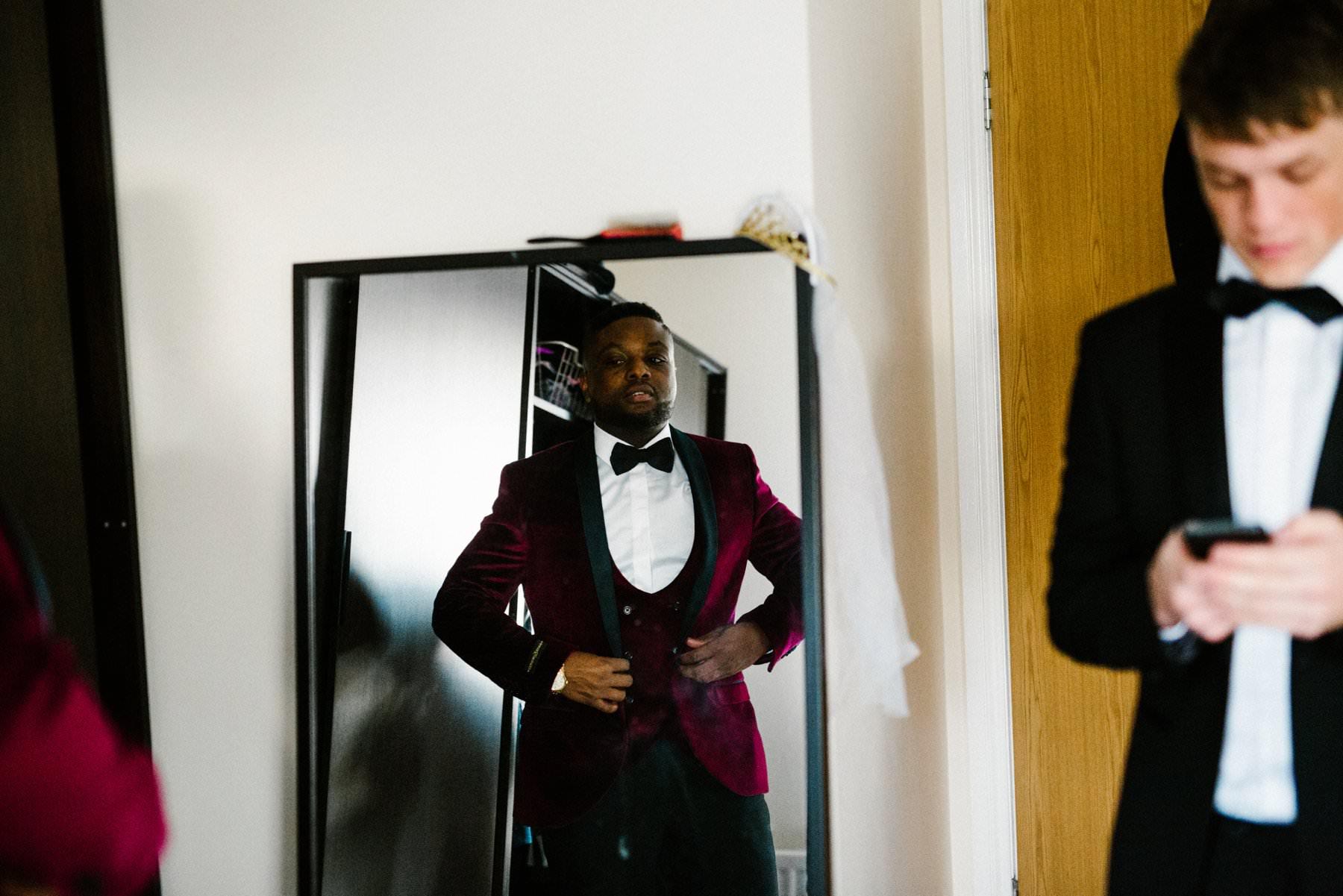 groom wearing red velvet tux wedding photography northern ireland