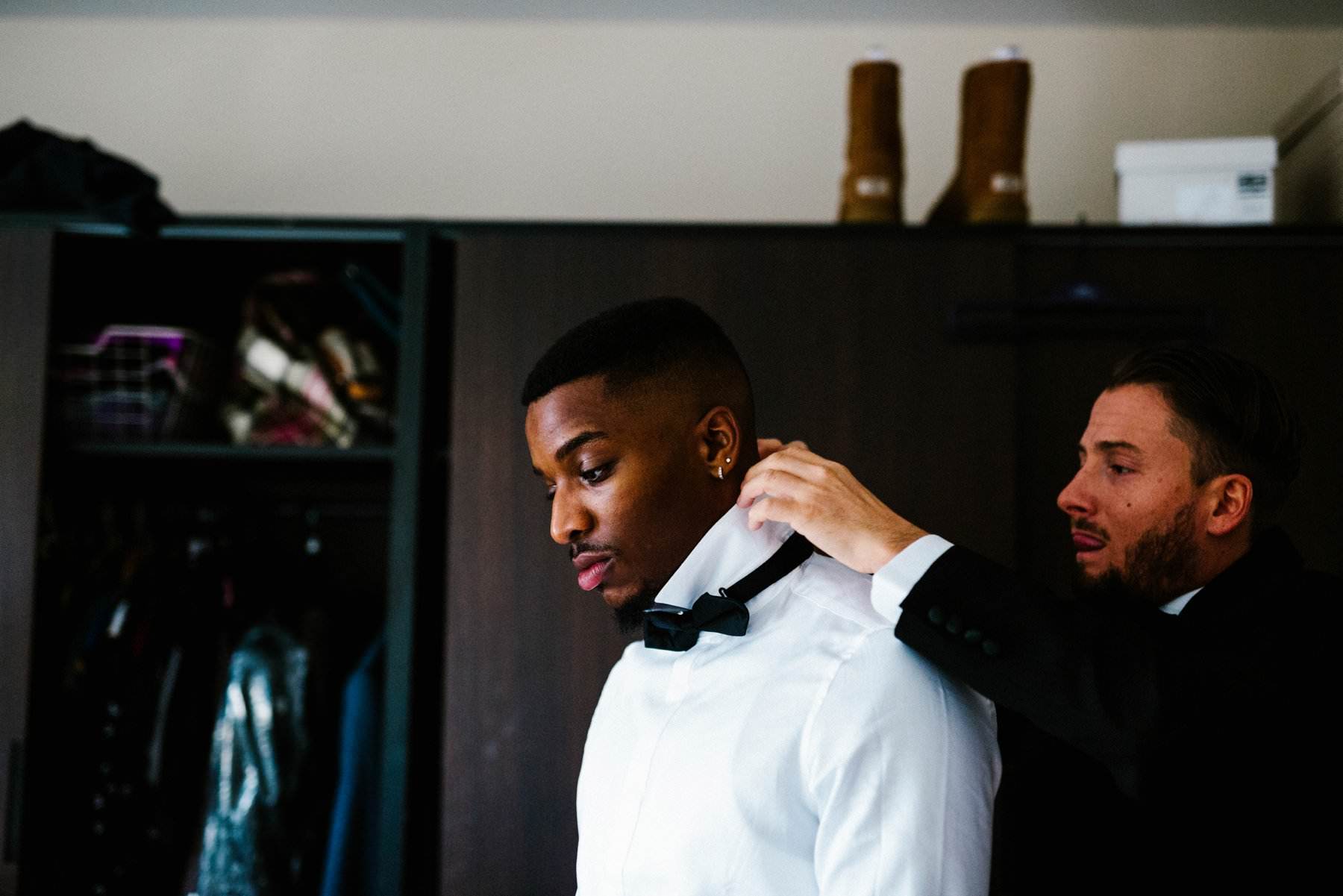 groomsmen tying bow tie wedding photography northern ireland