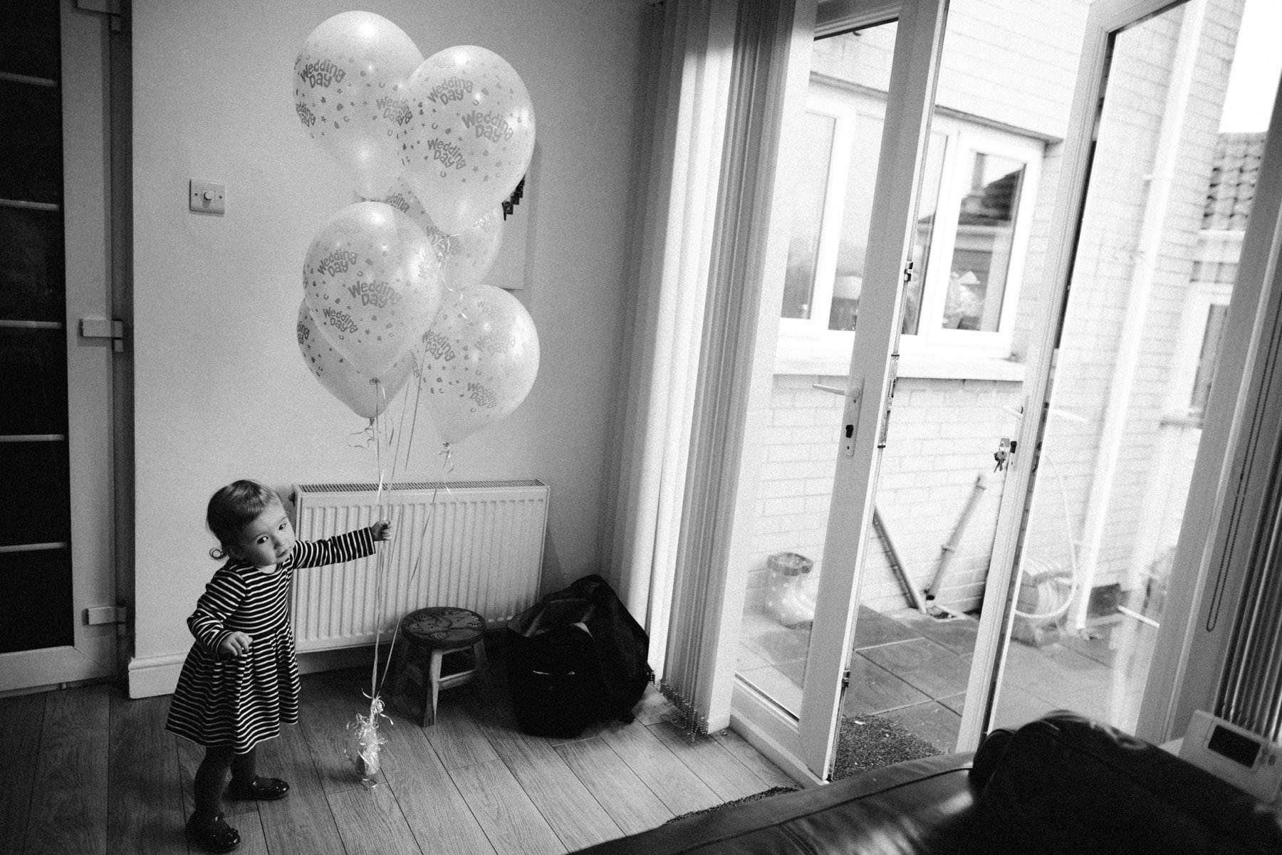 kid with balloons wedding photography northern irleland