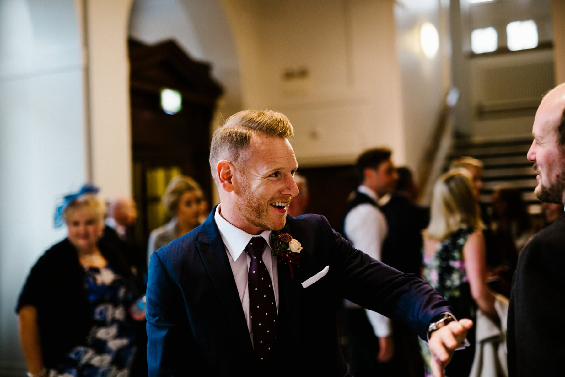 groom greets guests with a smile wedding photography northern ireland