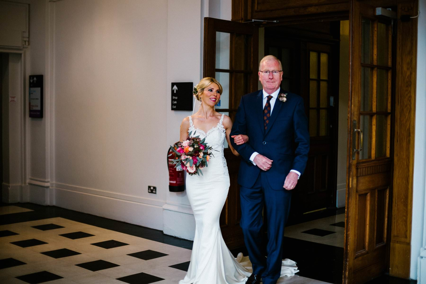 bride and her father enter the civil ceremony at the ulster museum