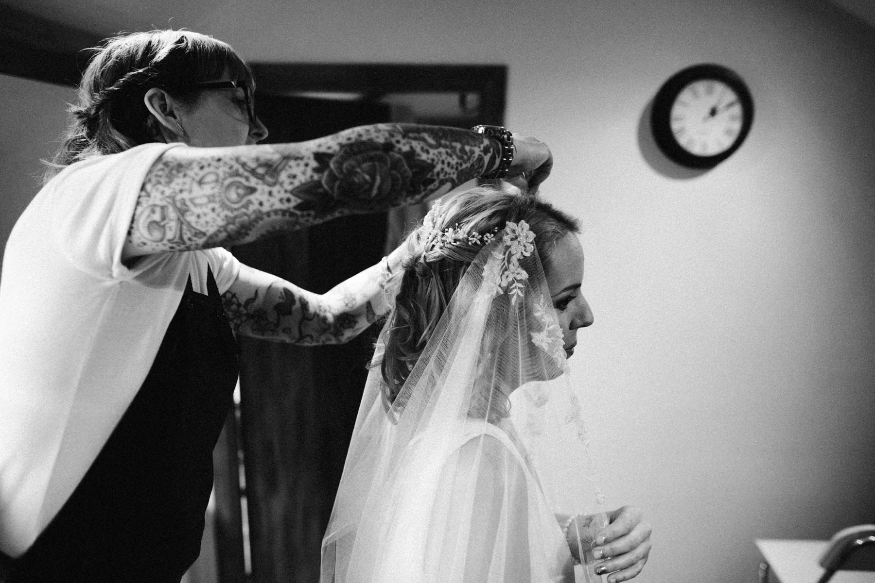 bride has her veil attached by Lynette Murray Hair