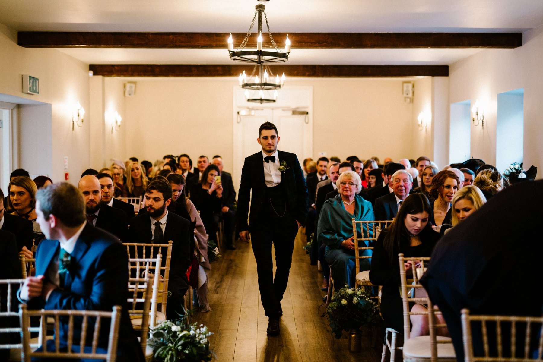 groom enters the ceremony room at Larchfield Estate