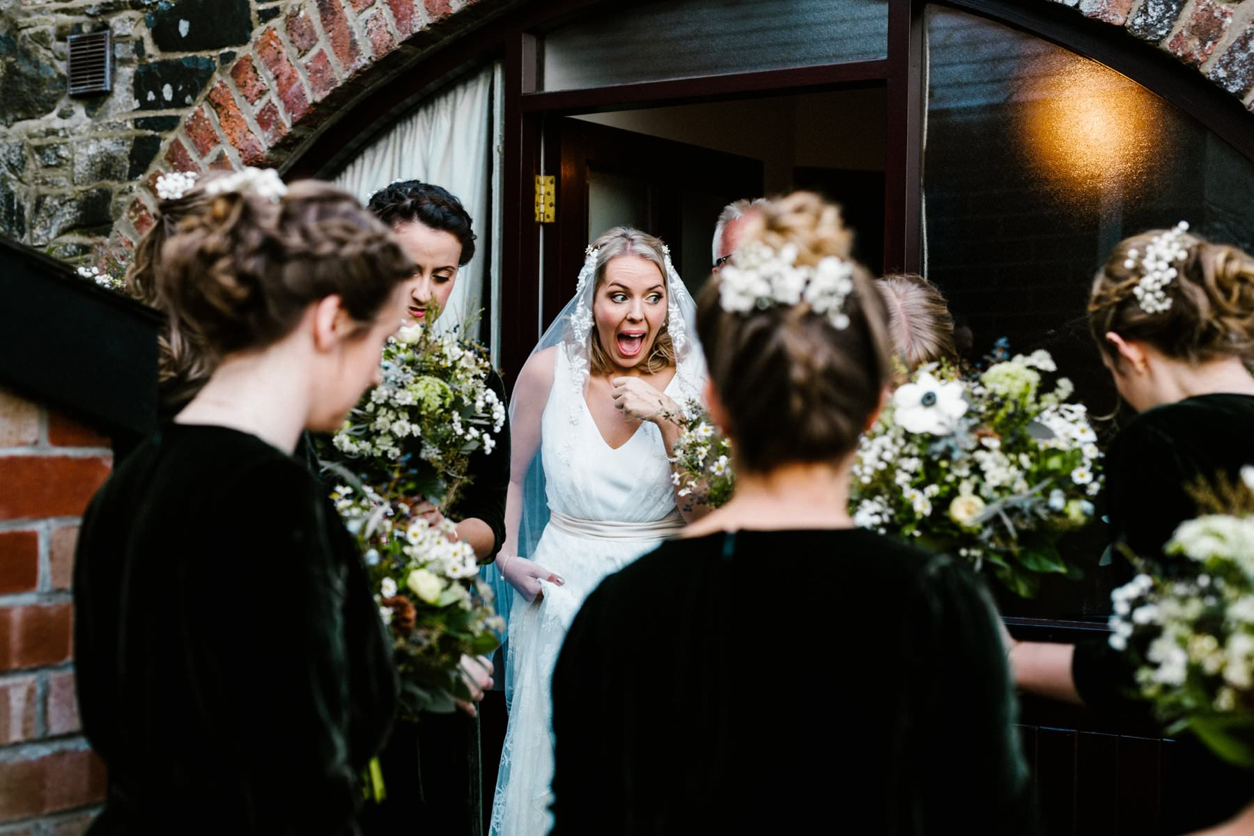 Excited bride surrounded by her bridesmaid on an Irish Estate wedding