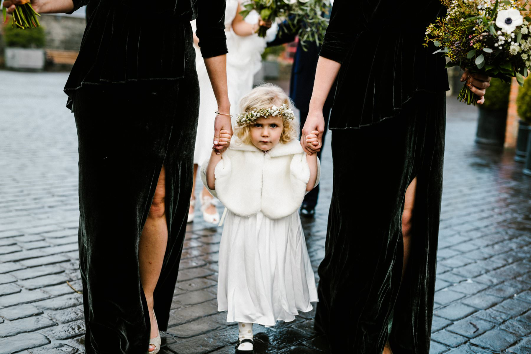 Cute flower girl at a winter wedding in Ireland