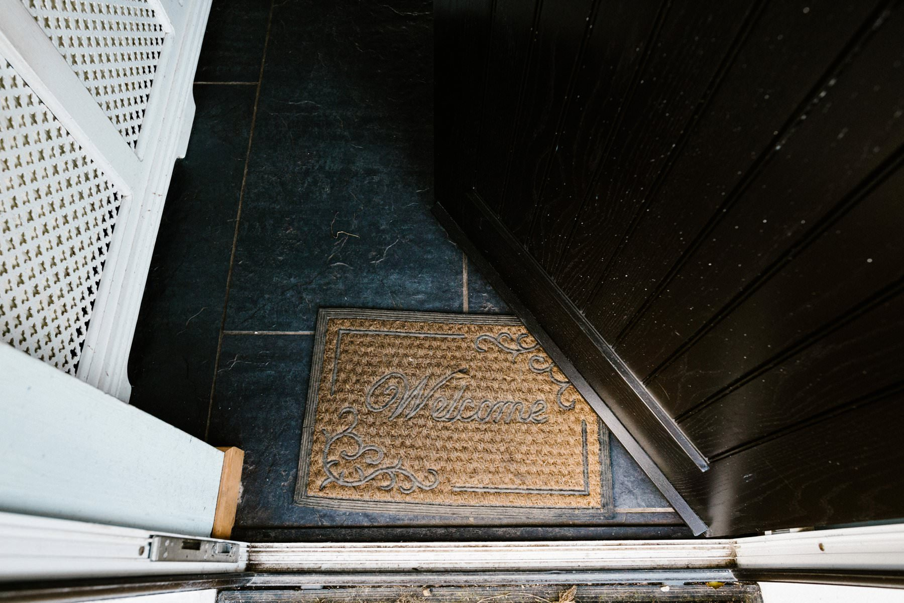 welcome mat at the grooms home wedding photography northern ireland