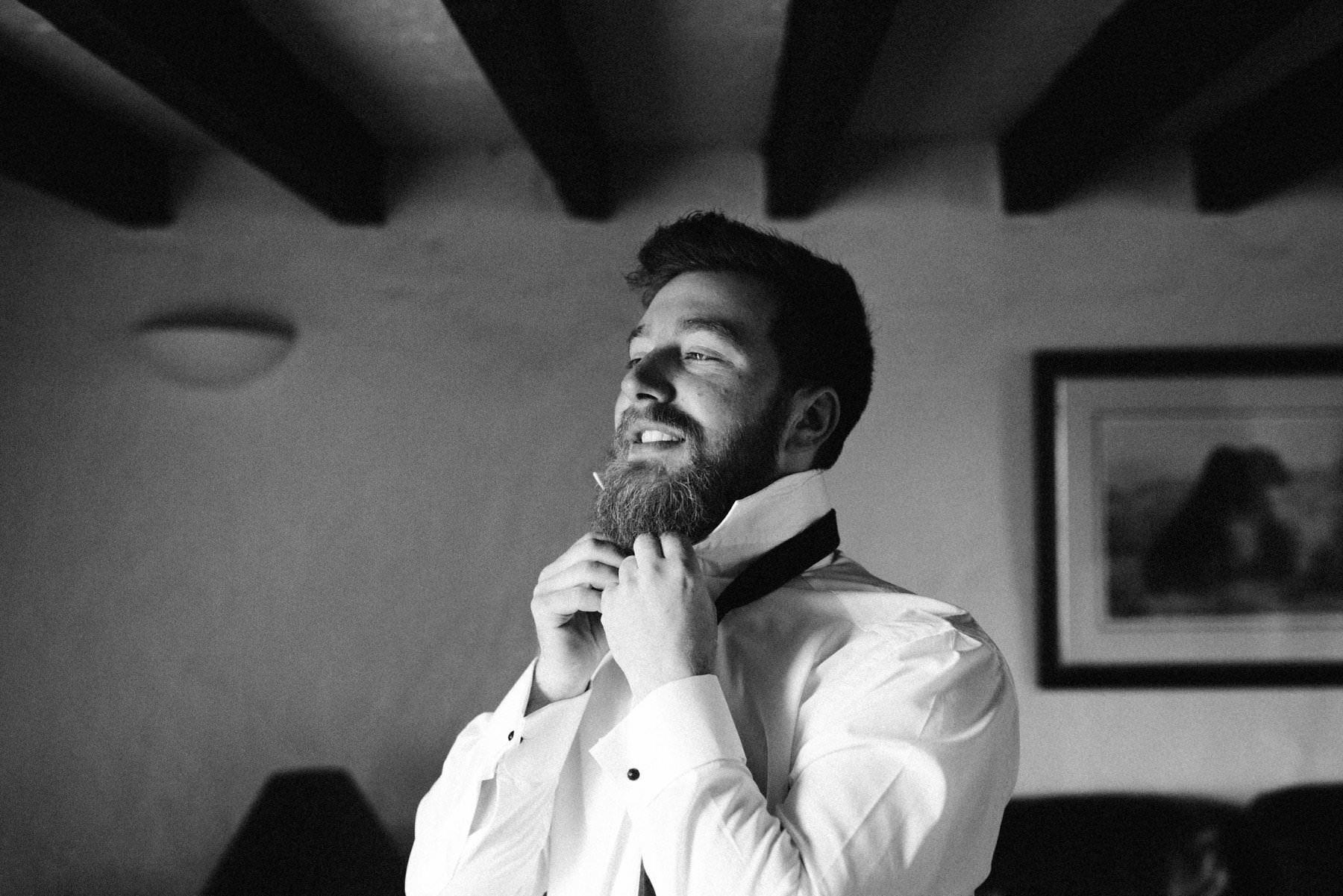 black and white of groom addicting his tie wedding photography northern ireland