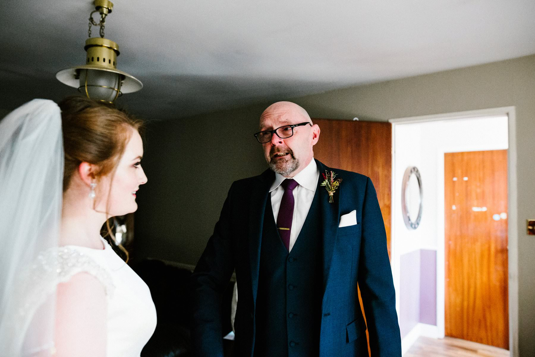 father of the bride gets emotional when he sees his daughter