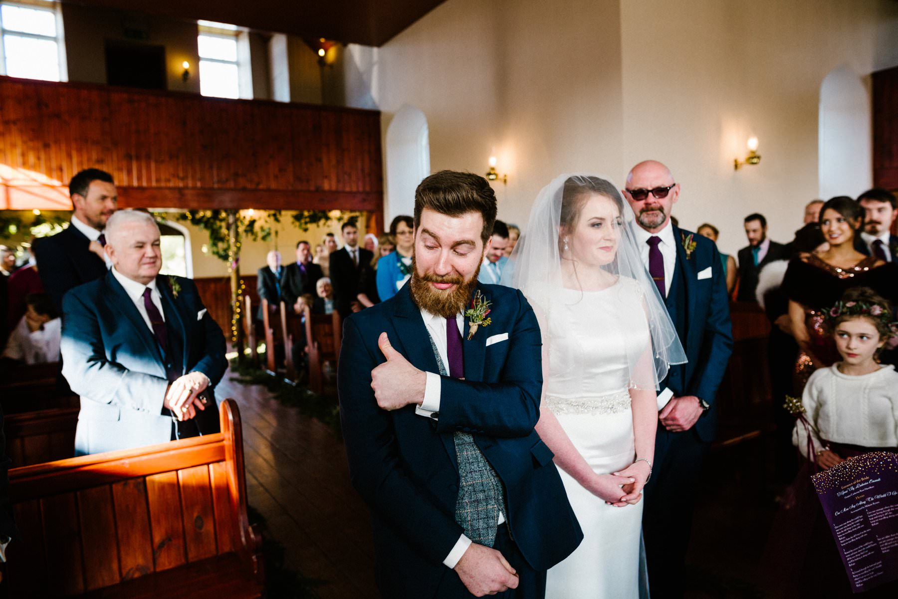 groom gives thumbs up when he sees his bride wedding photographer northern ireland