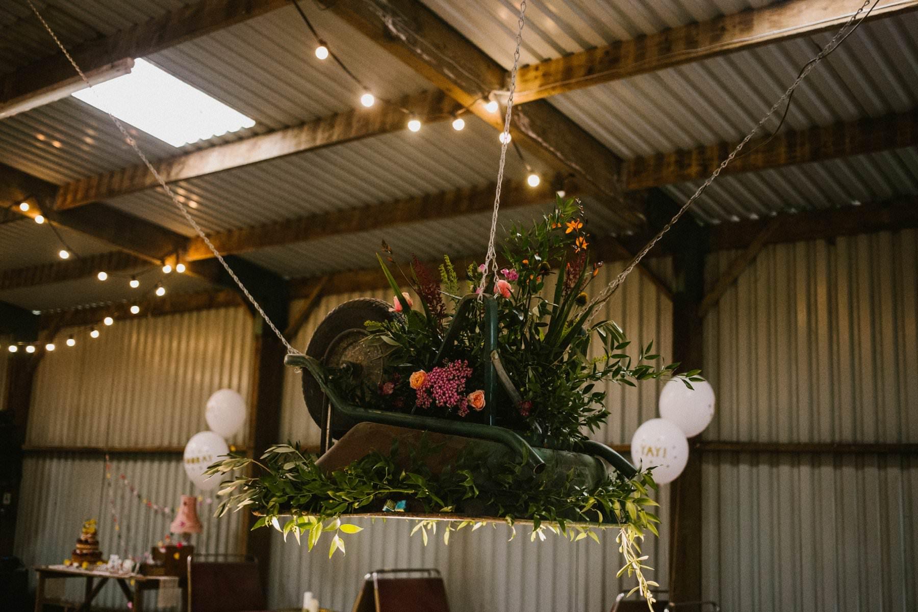 creative use of wheel barrow wedding photography