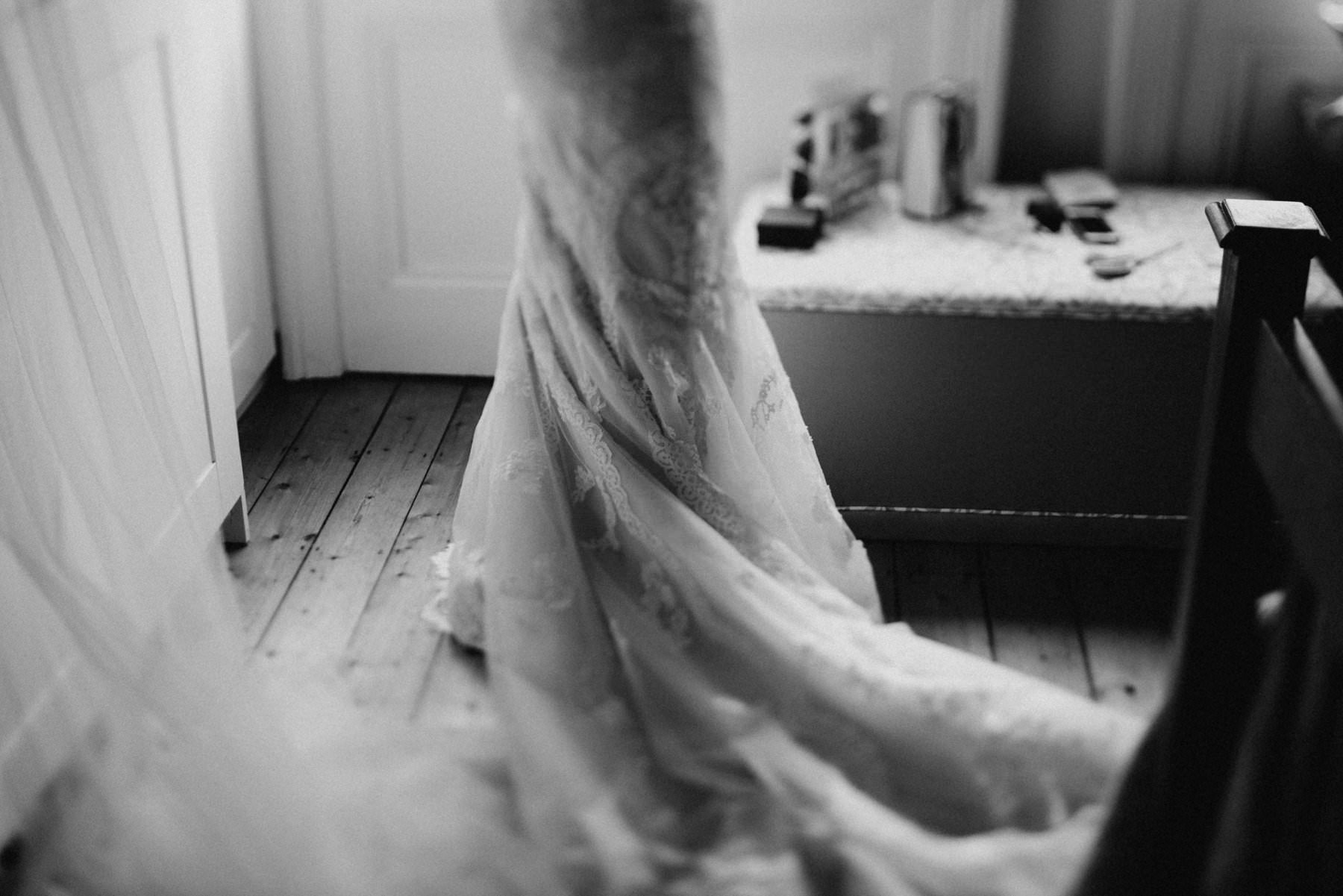 black and white photograph of bride getting dress for her dublin wedding
