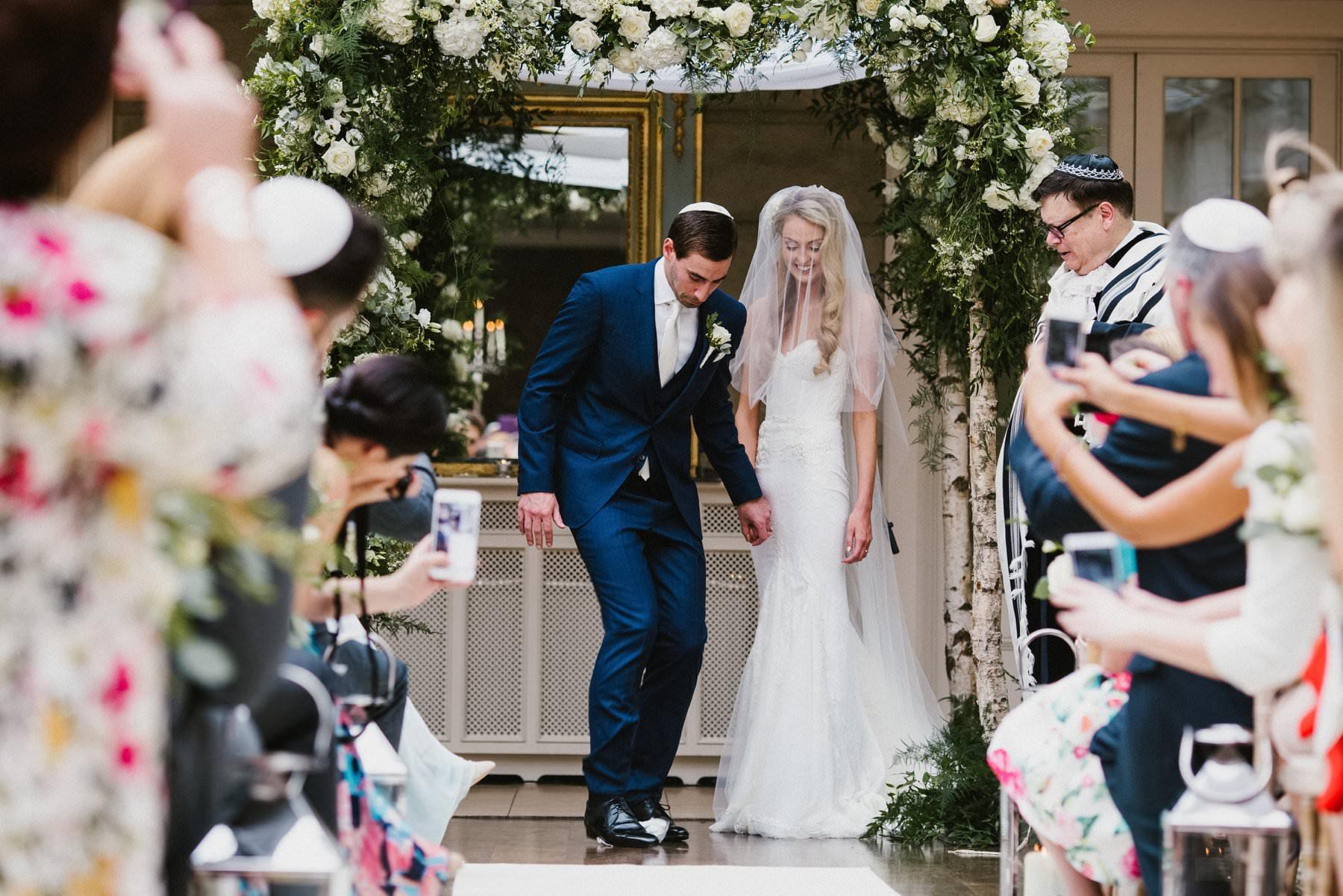 jewish wedding couple smash glass in Tankardstown House