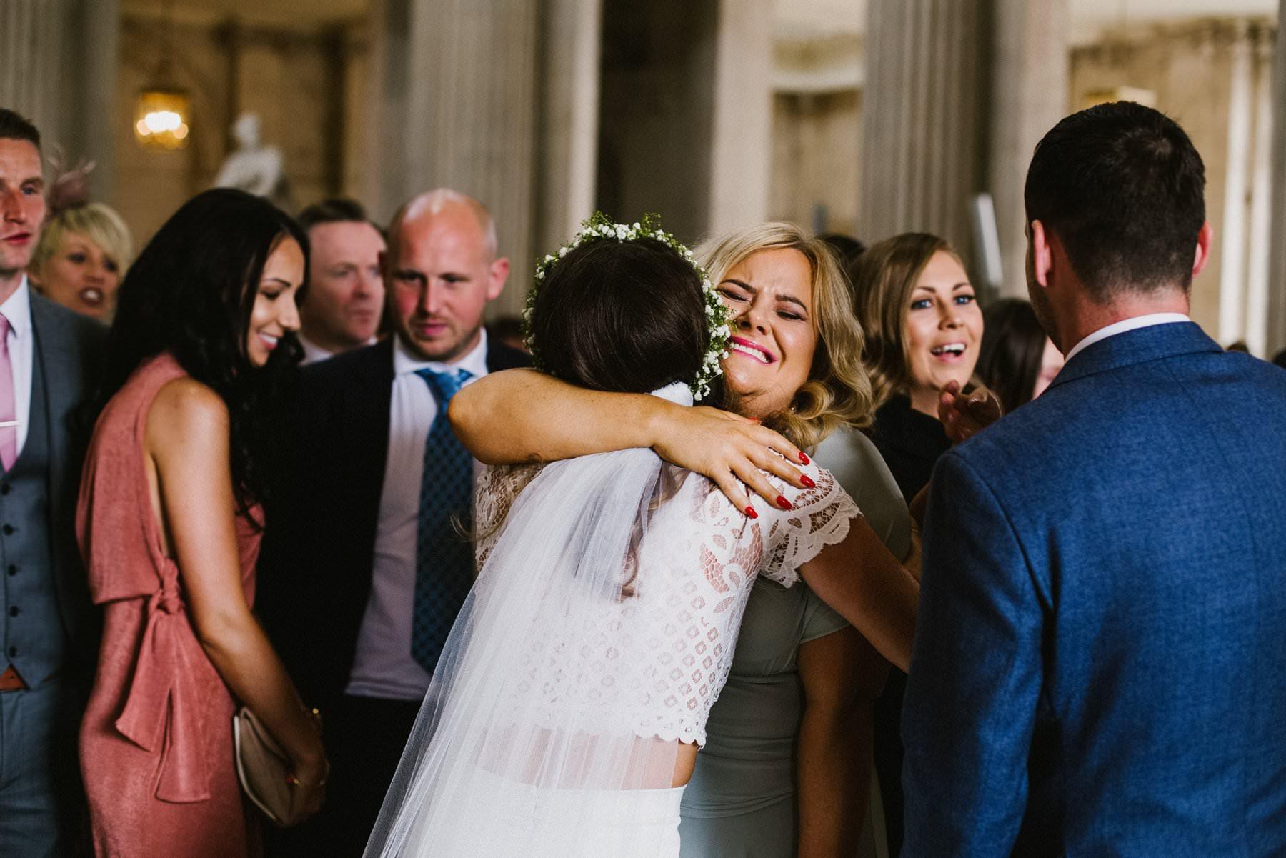 bride receives emotive hug from wedding guest at Dublin City Hall wedding