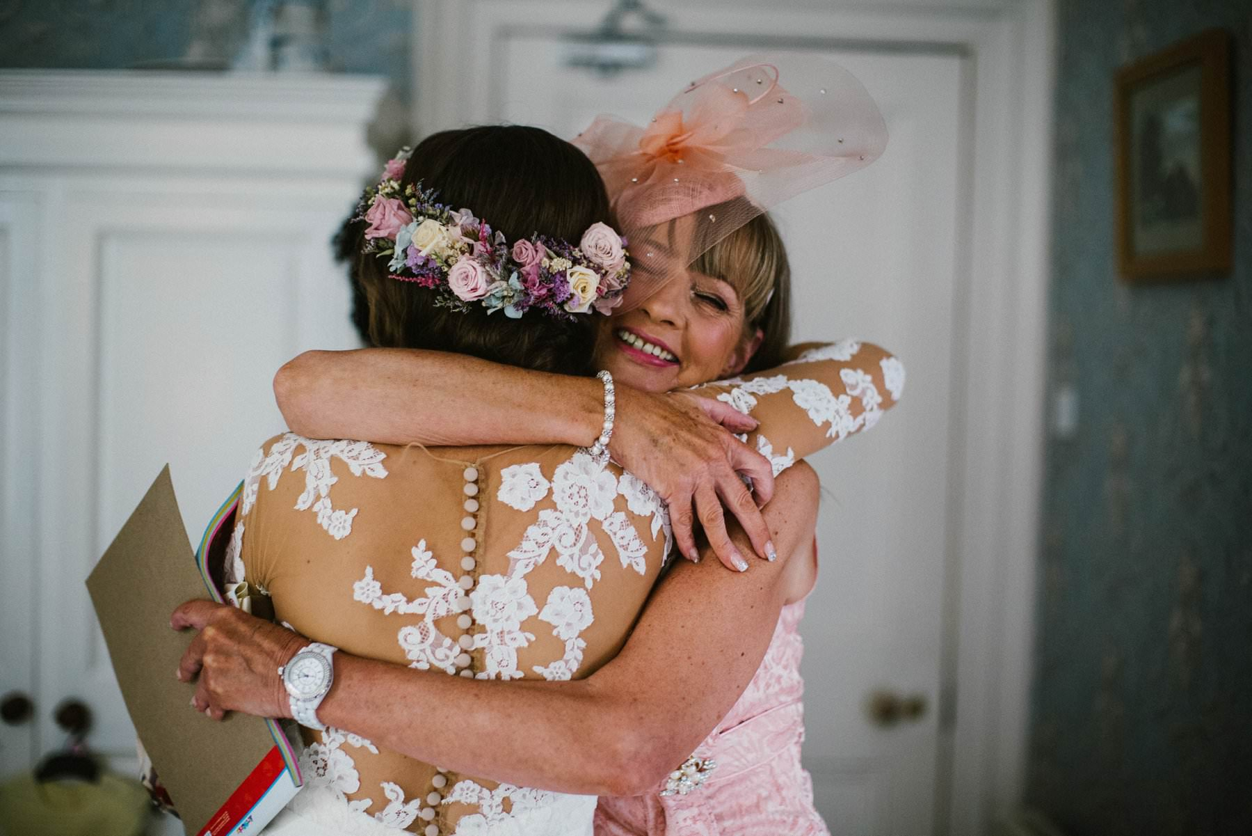 mother of the bride hugs the bride before wedding in Lurgan Northern Ireland