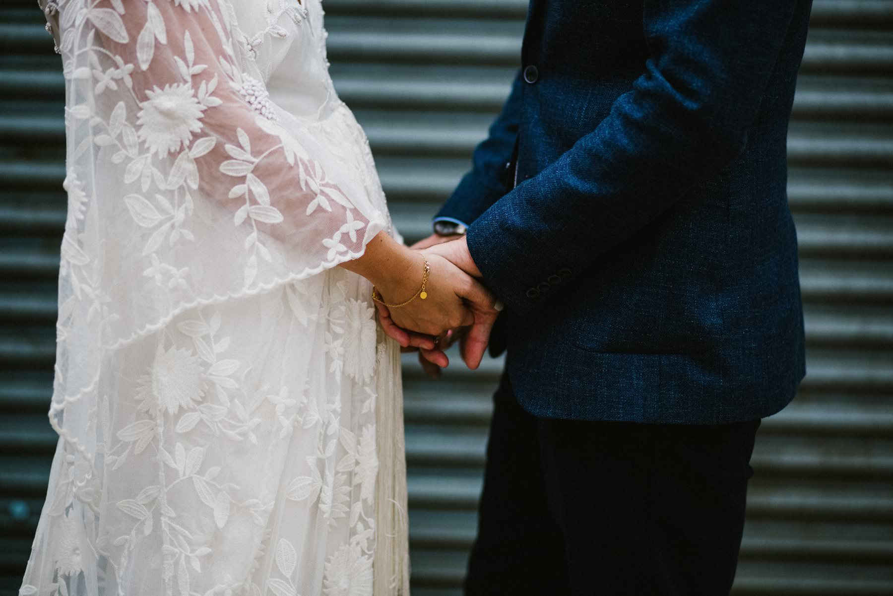 bride and groom hold hand wedding photography northern ireland