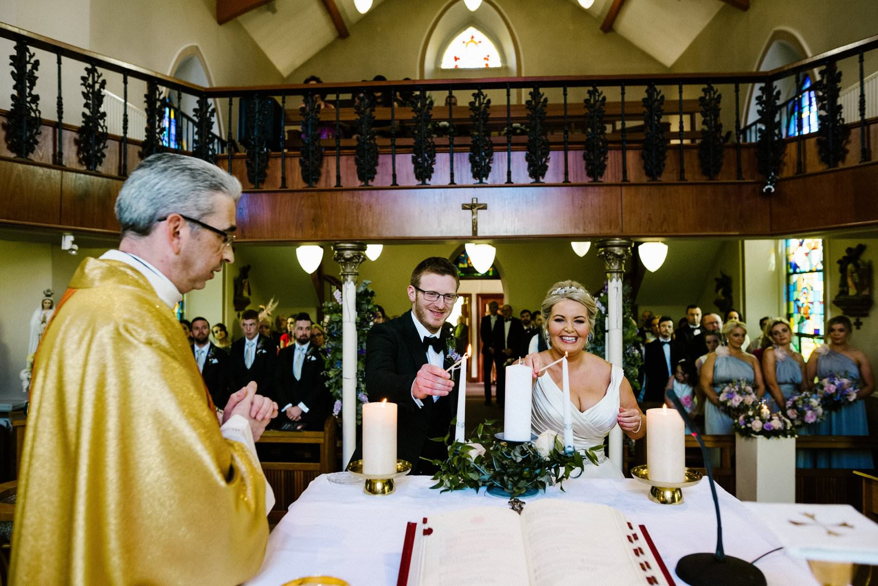 groom and bride light ceremonial candles in dungannon