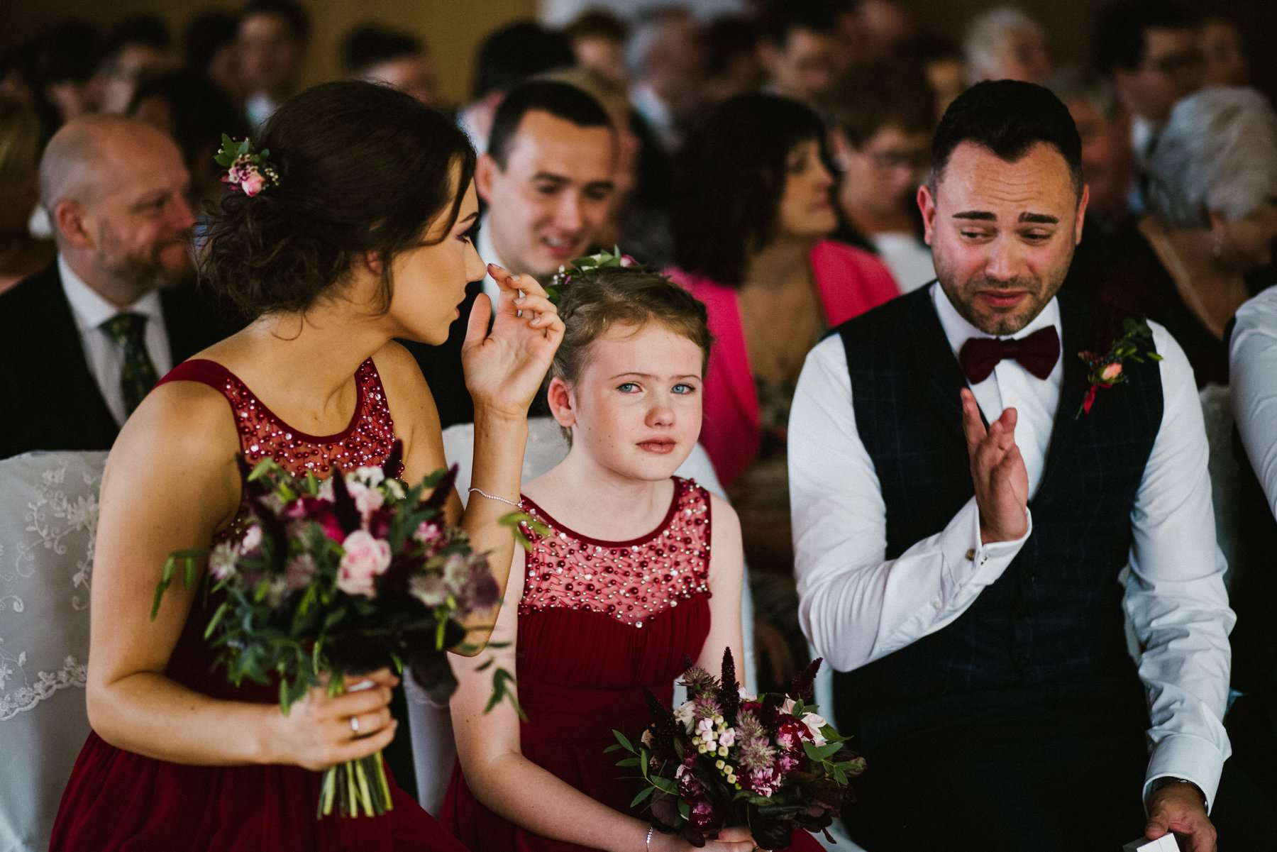 emotional wedding guests at wedding ceremony in Ballygally Castle