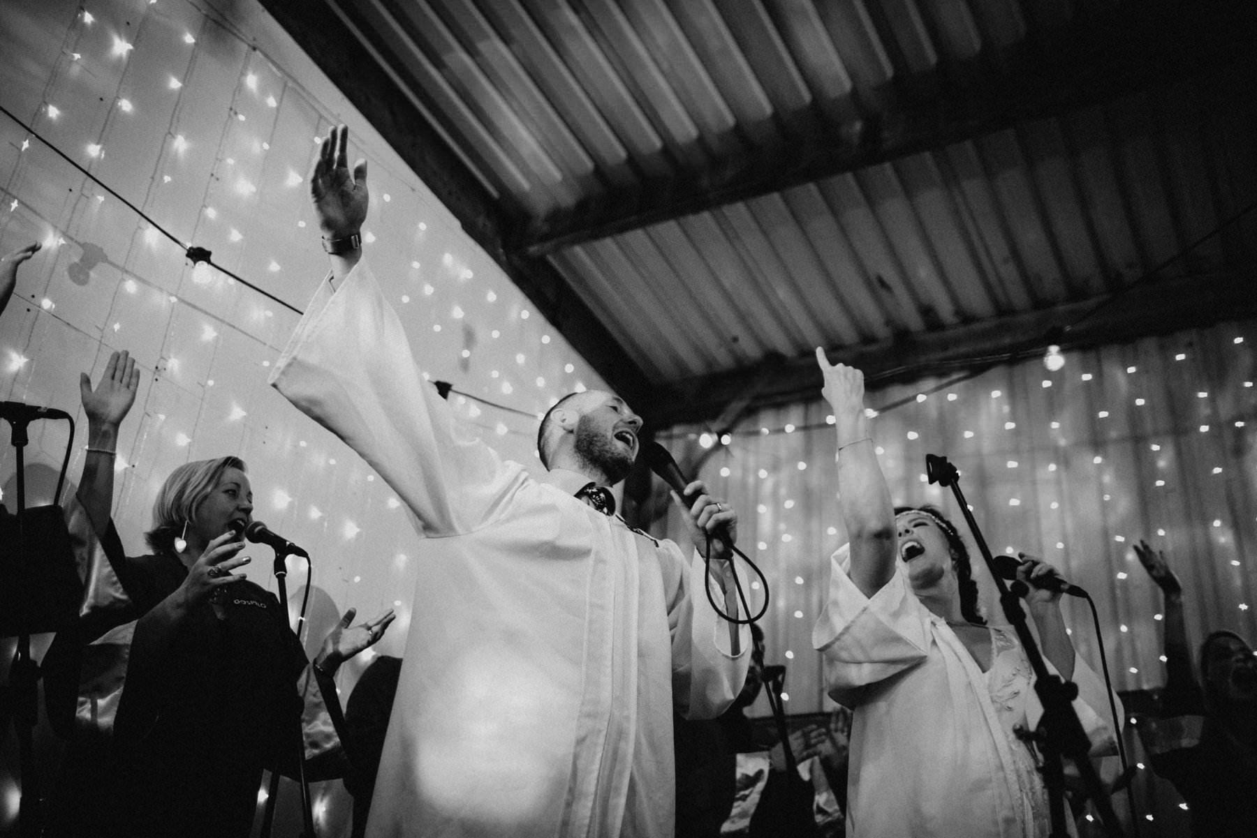 bride and groom sing karaoke