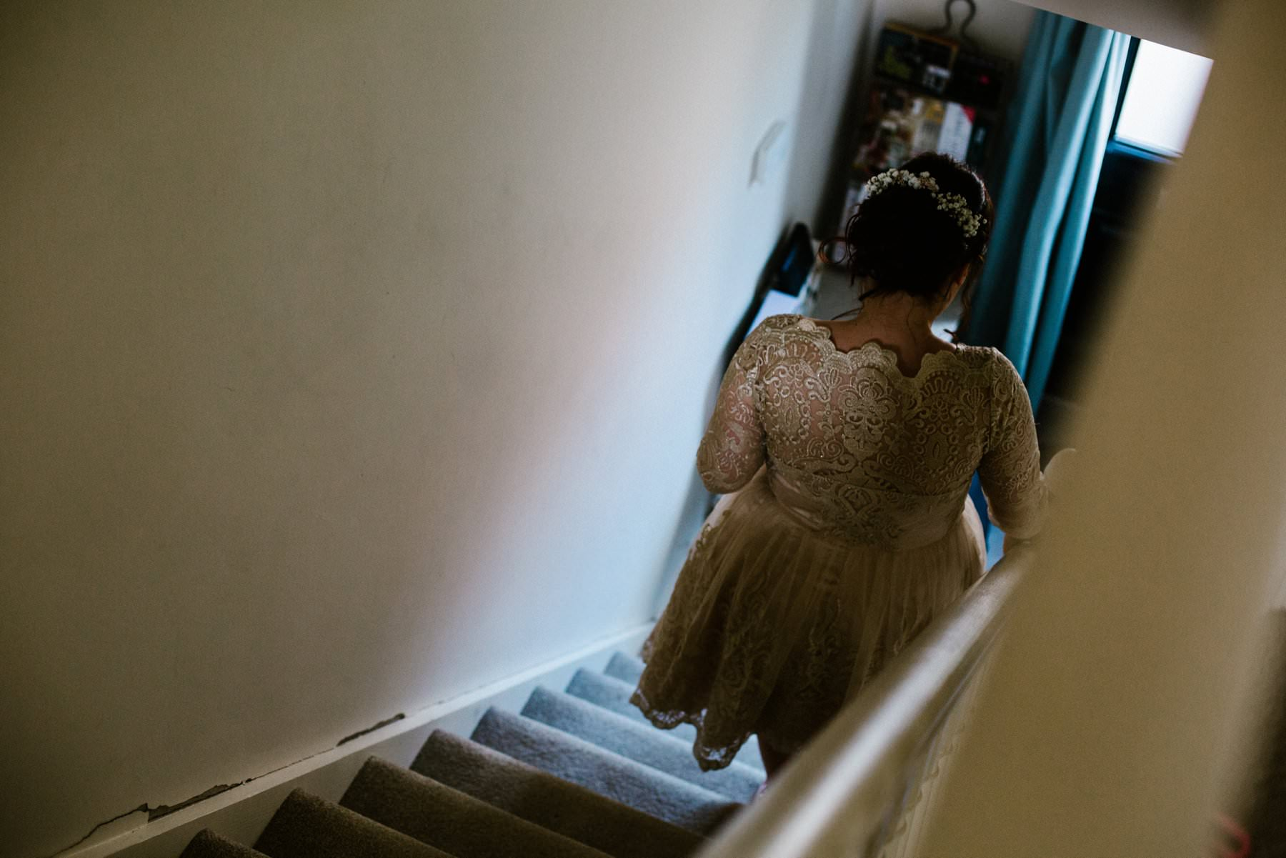 bride walking downstairs, wedding photographer northern ireland