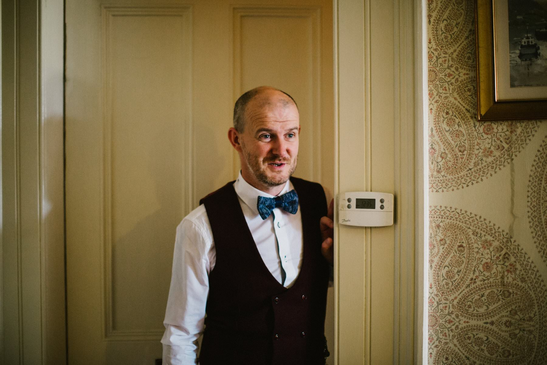 groom in maroon waistcoat and blue dickie bow  northern ireland