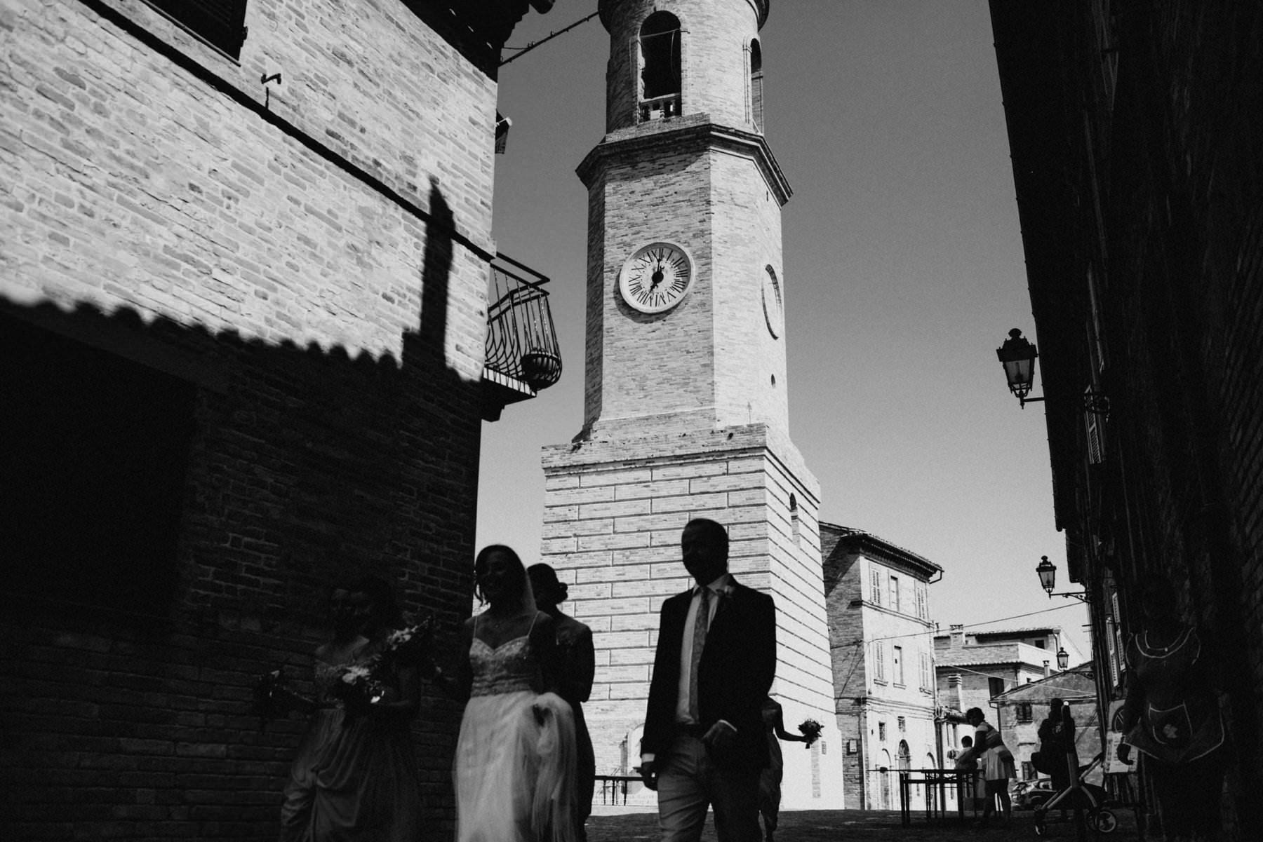 bride walks through italian town square