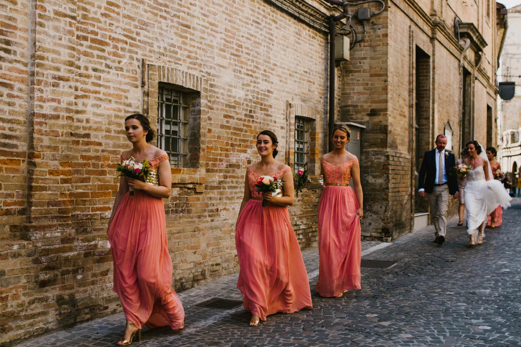 bride and bridesmaids arrive to chapel in italy