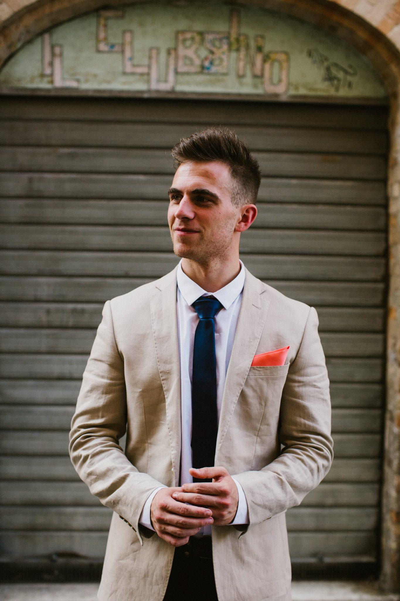 groom portrait in an italian street by irish wedding photographer