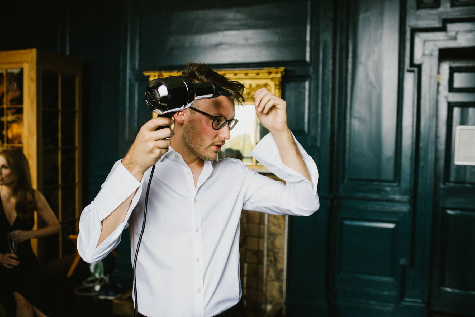 groom dries hair before wedding ceremony in Bellinter House Ireland