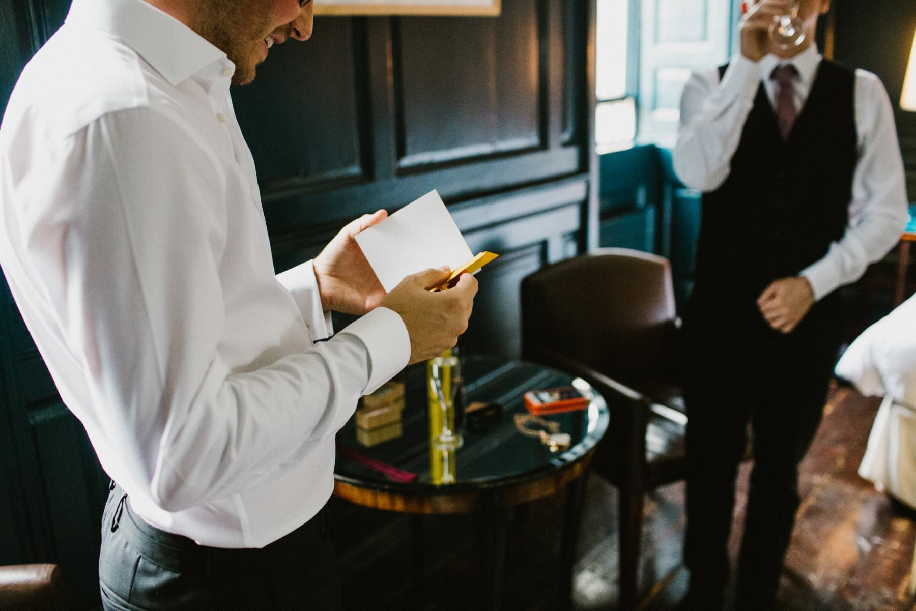 groom reads card from future husband