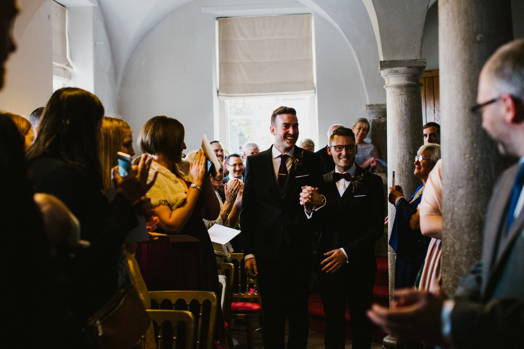 two grooms walk down the aisle bellinter house