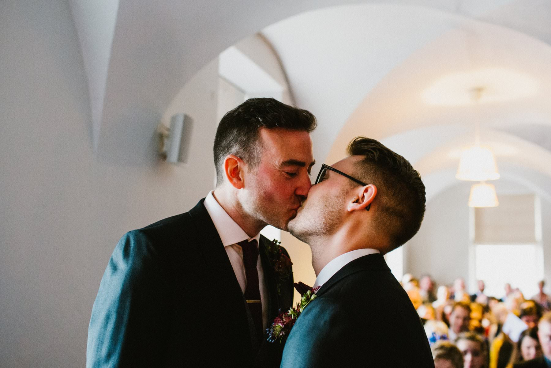 first kiss of two grooms in ireland