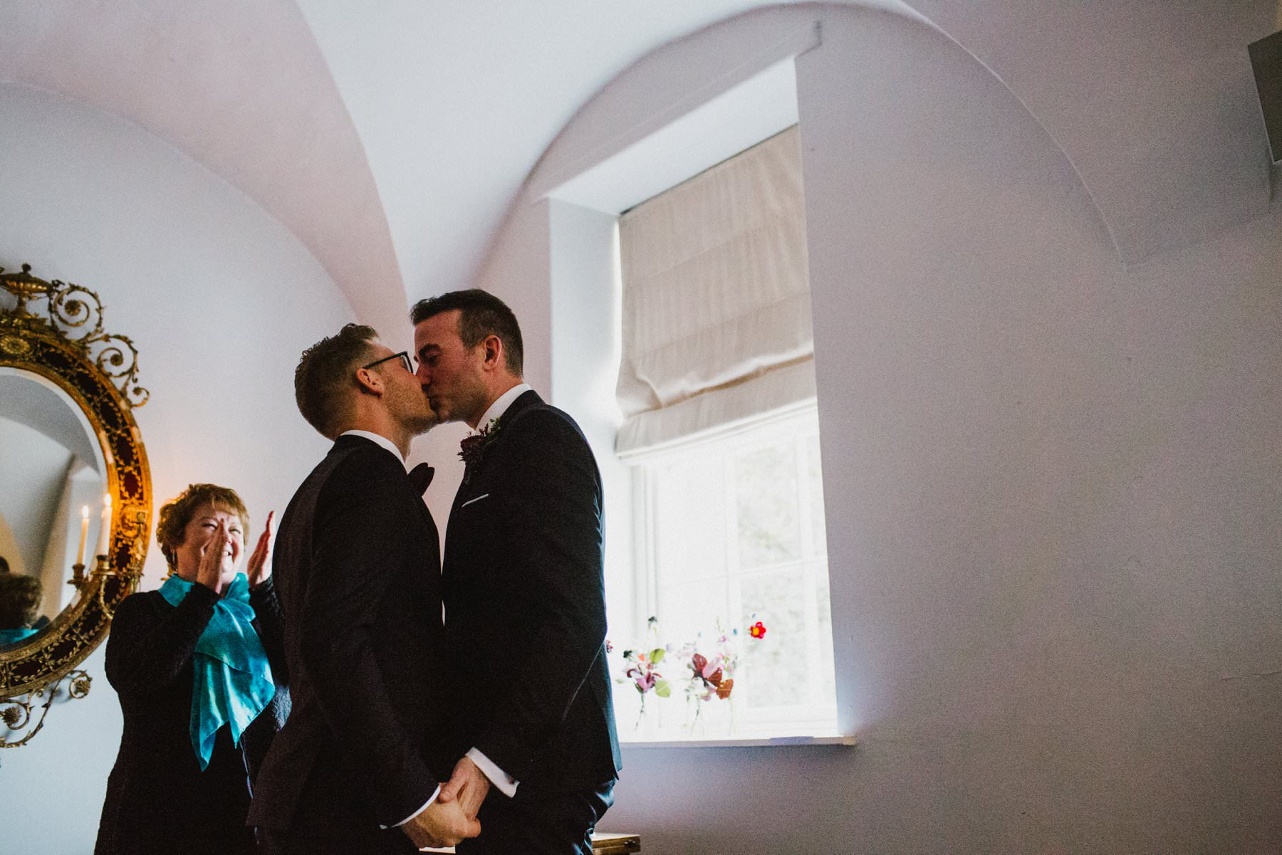 two grooms share a kiss after their same sex wedding in ireland