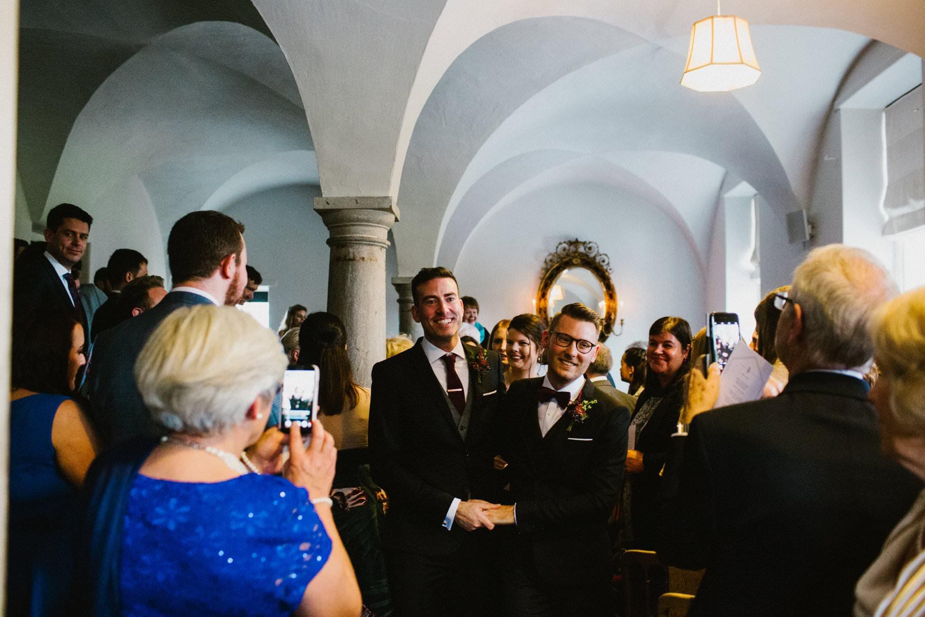 two husbands walk down aisle in bellinter house