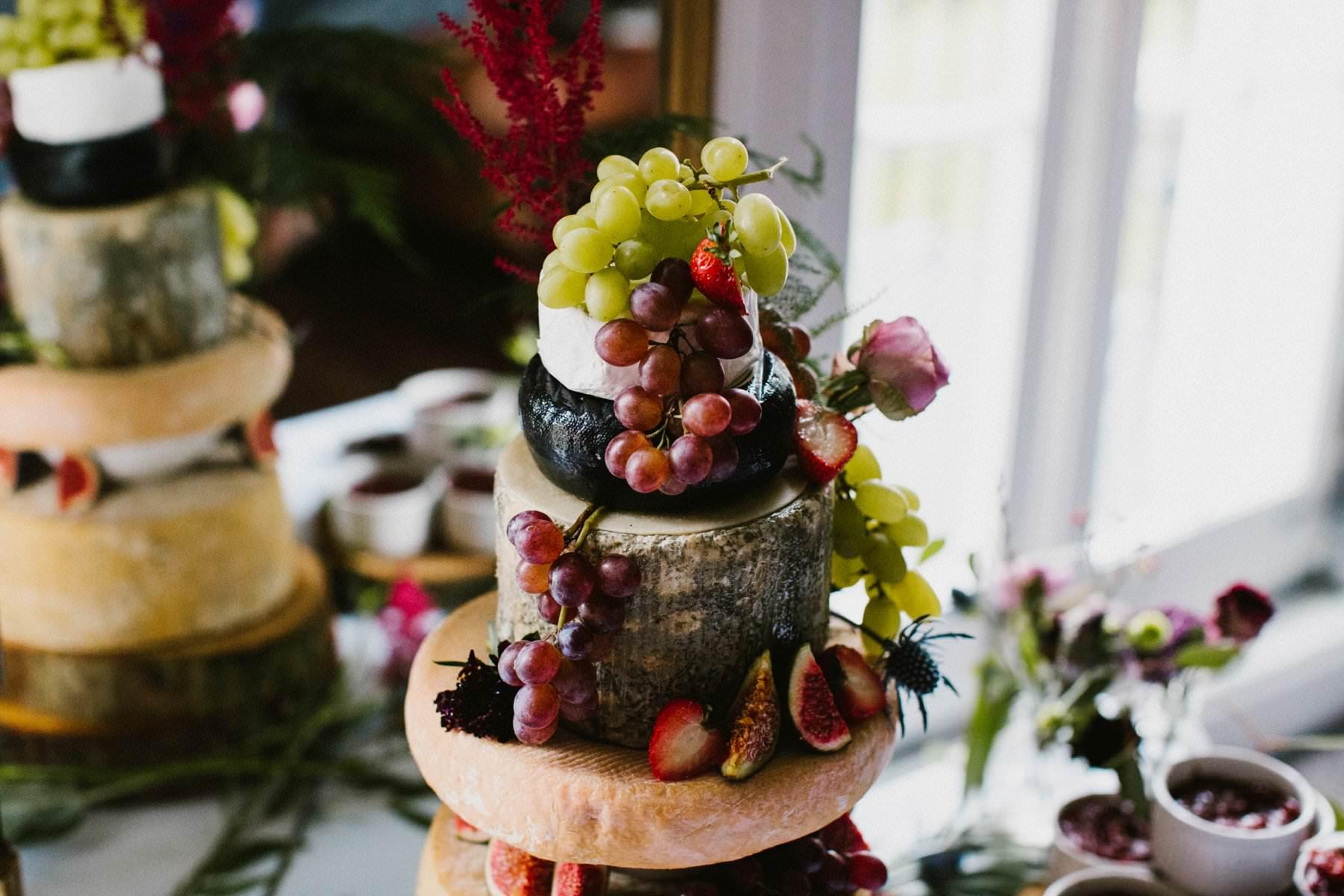 close up detail of wedding cake make of cheese wheel