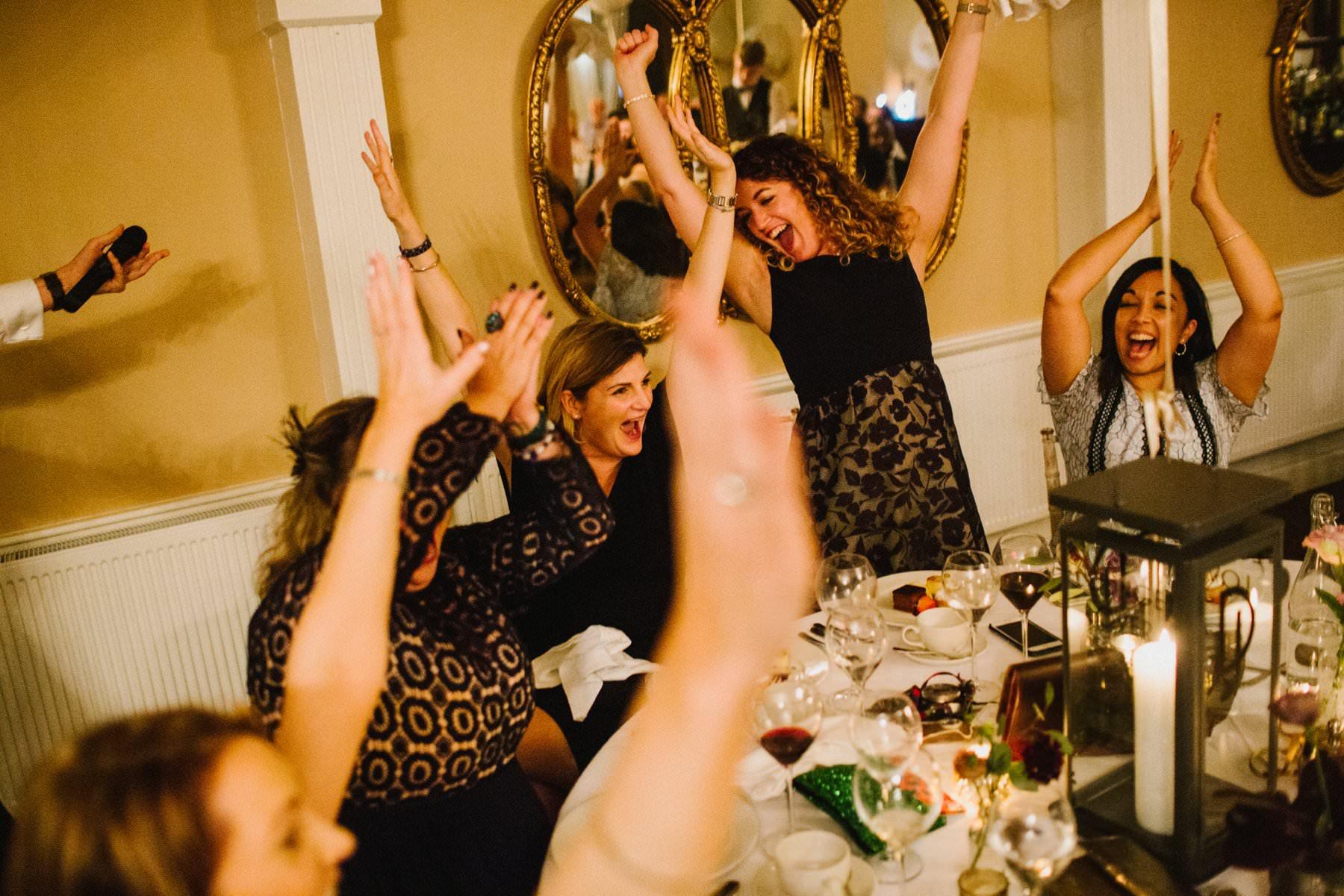 wedding guests celebrate winning table quiz