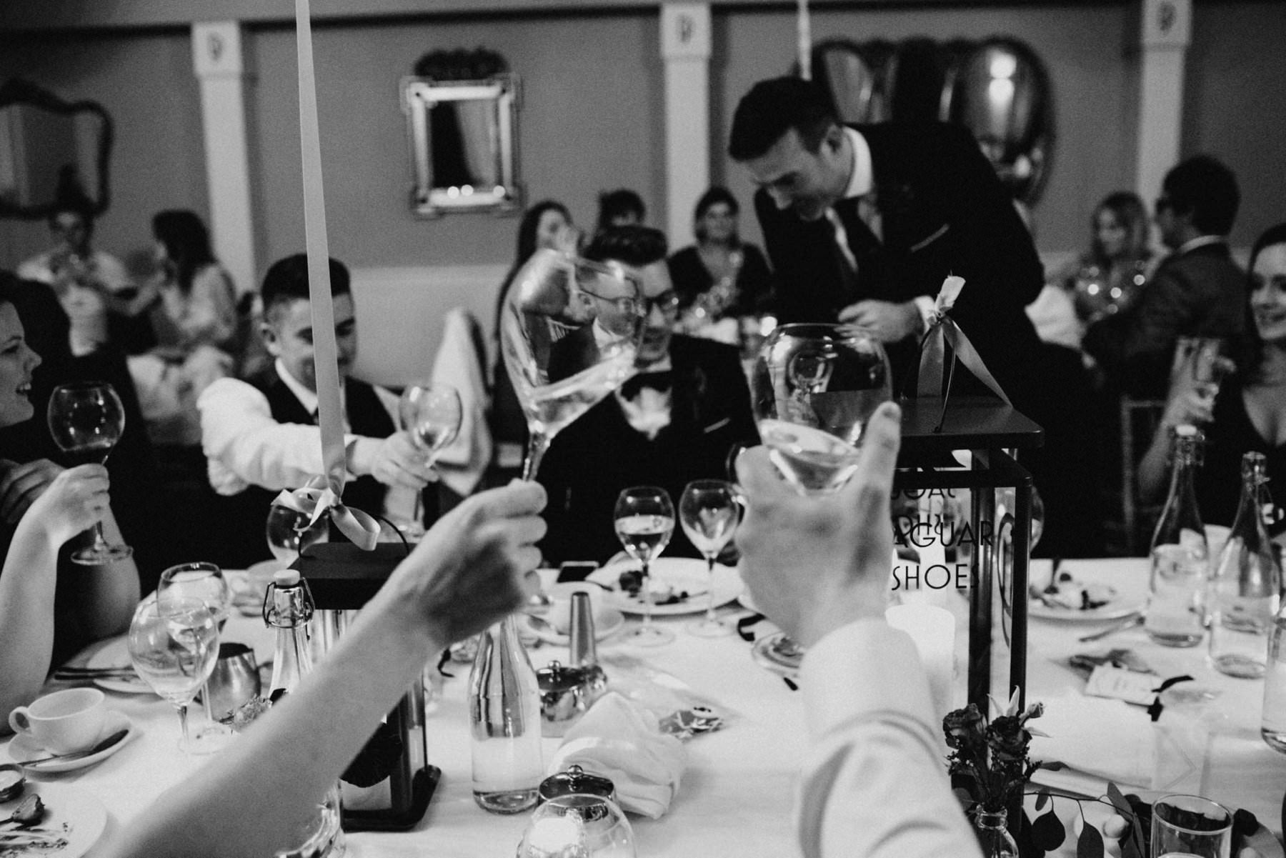 wedding guests toast their wine glasses