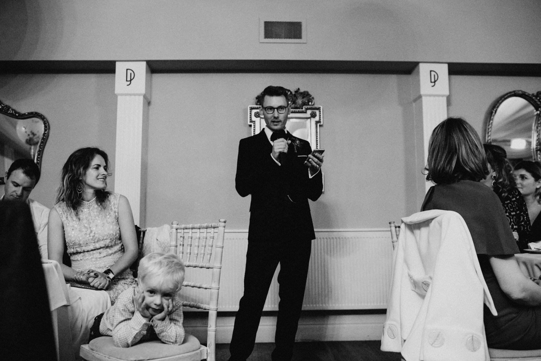 documentary wedding photography, little boy bored as groom makes speeches