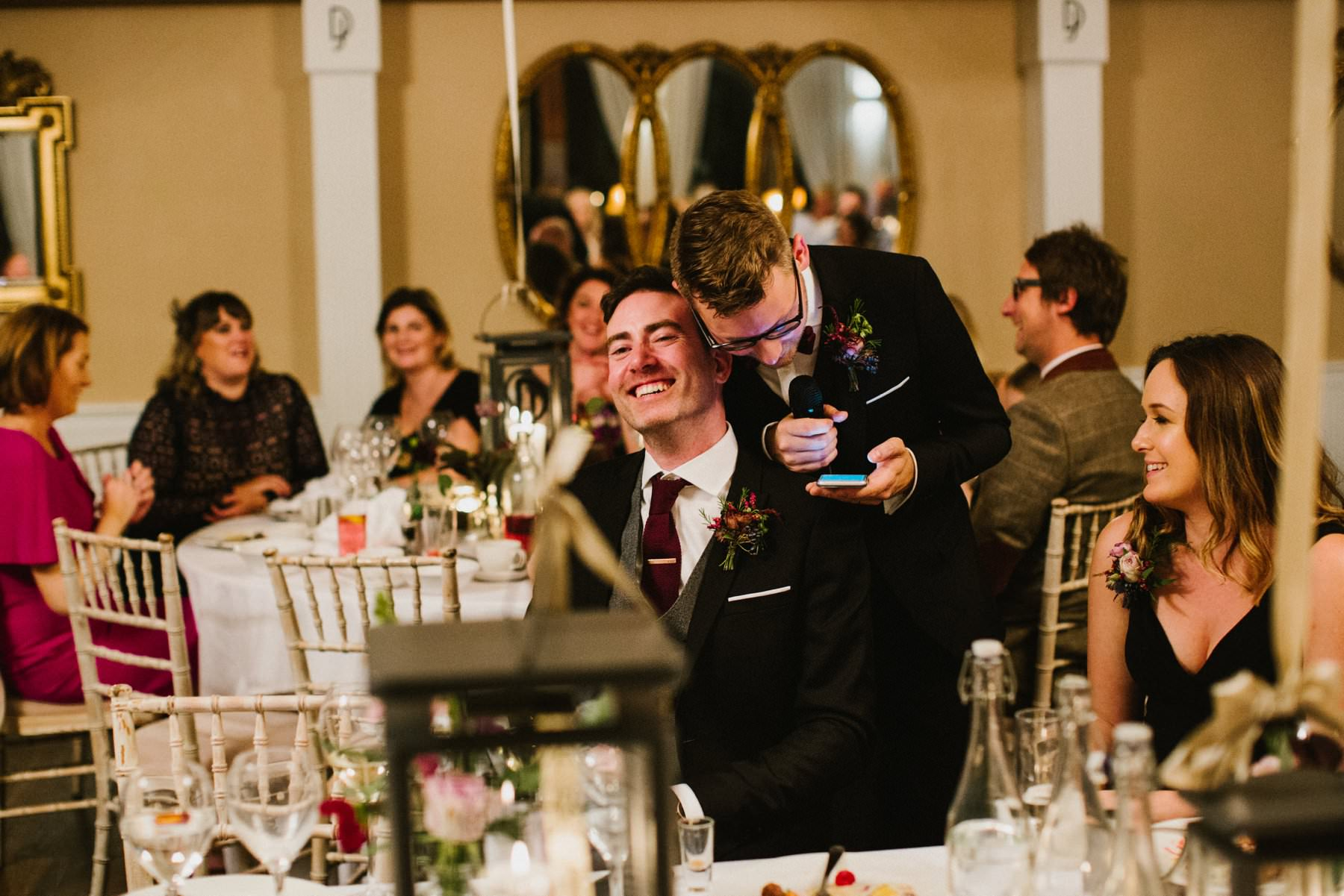 two grooms share moment during speeches
