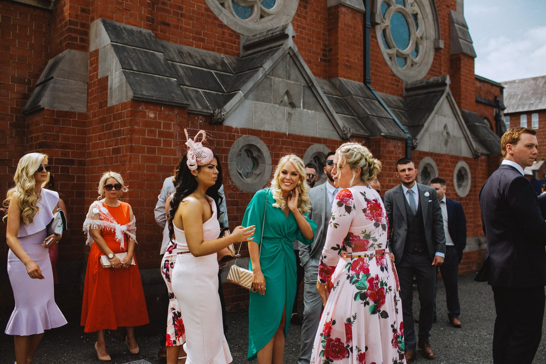 Wedding guests gather before wedding at Good Shepherd Church Ormeau Road Belfast
