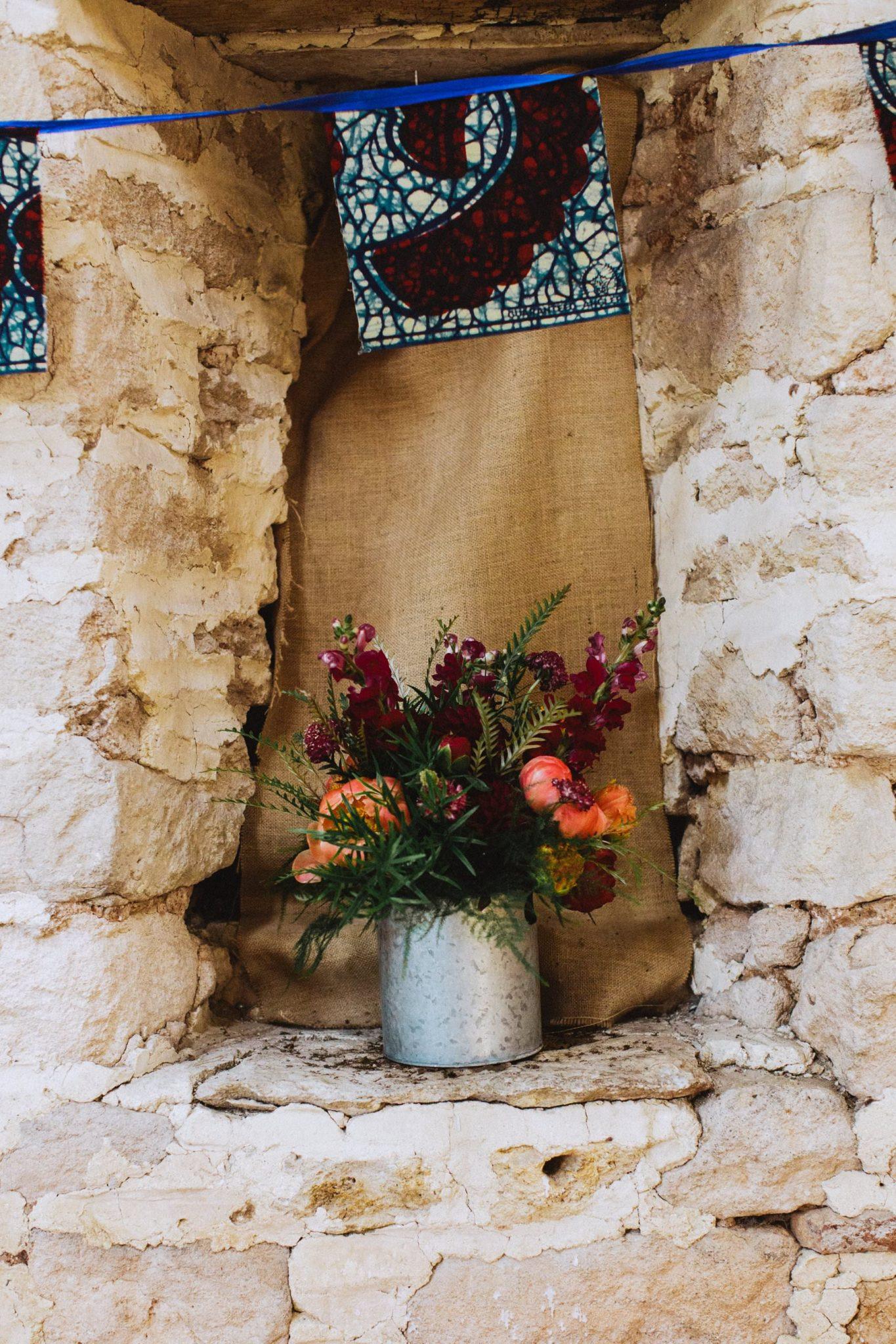 floral arrangement in ceremony room of bath wedding