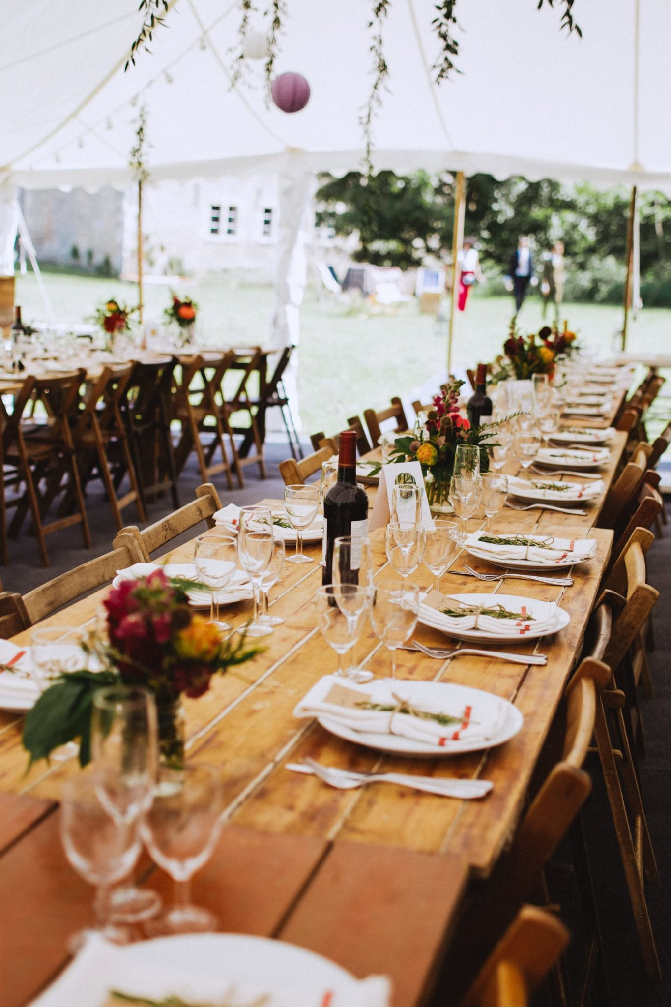 long tables for rustic marquee wedding reception in bath somerset