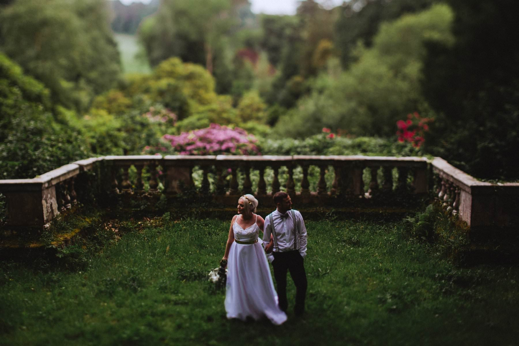 newlyweds pose in the gardens of drenagh house estate just outside limavady northern ireland