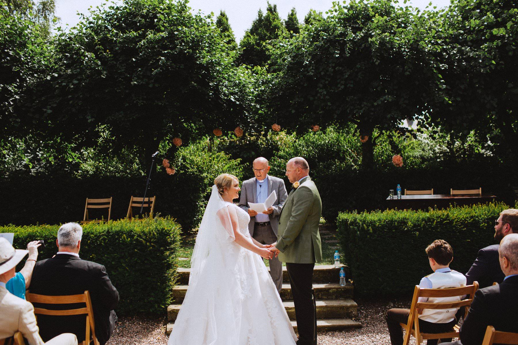 outdoor wedding ceremony at larchfield estate northern ireland